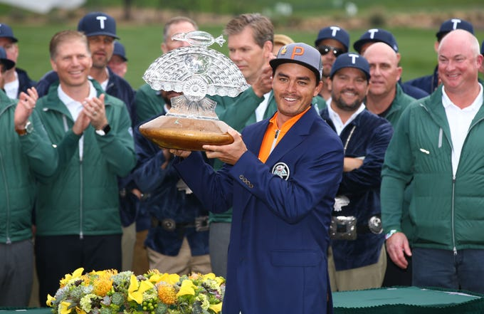 Rickie Fowler holds-up the trophy after winning the Waste Management Phoenix Open on Feb. 3 at the TPC Scottsdale Stadium Course.