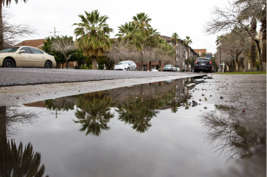 Water pools on the ground on 2nd Avenue after rainfall, Feb. 3, 2019.
