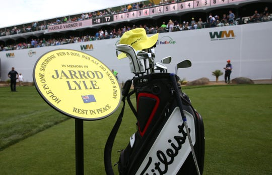 A yellow hat and golf bag on the 16th tee honors the late Jarrod Lyle, who died last summer from leukemia,during third round action at the 2019 Waste Management Phoenix Open at the TPC Scottsdale.