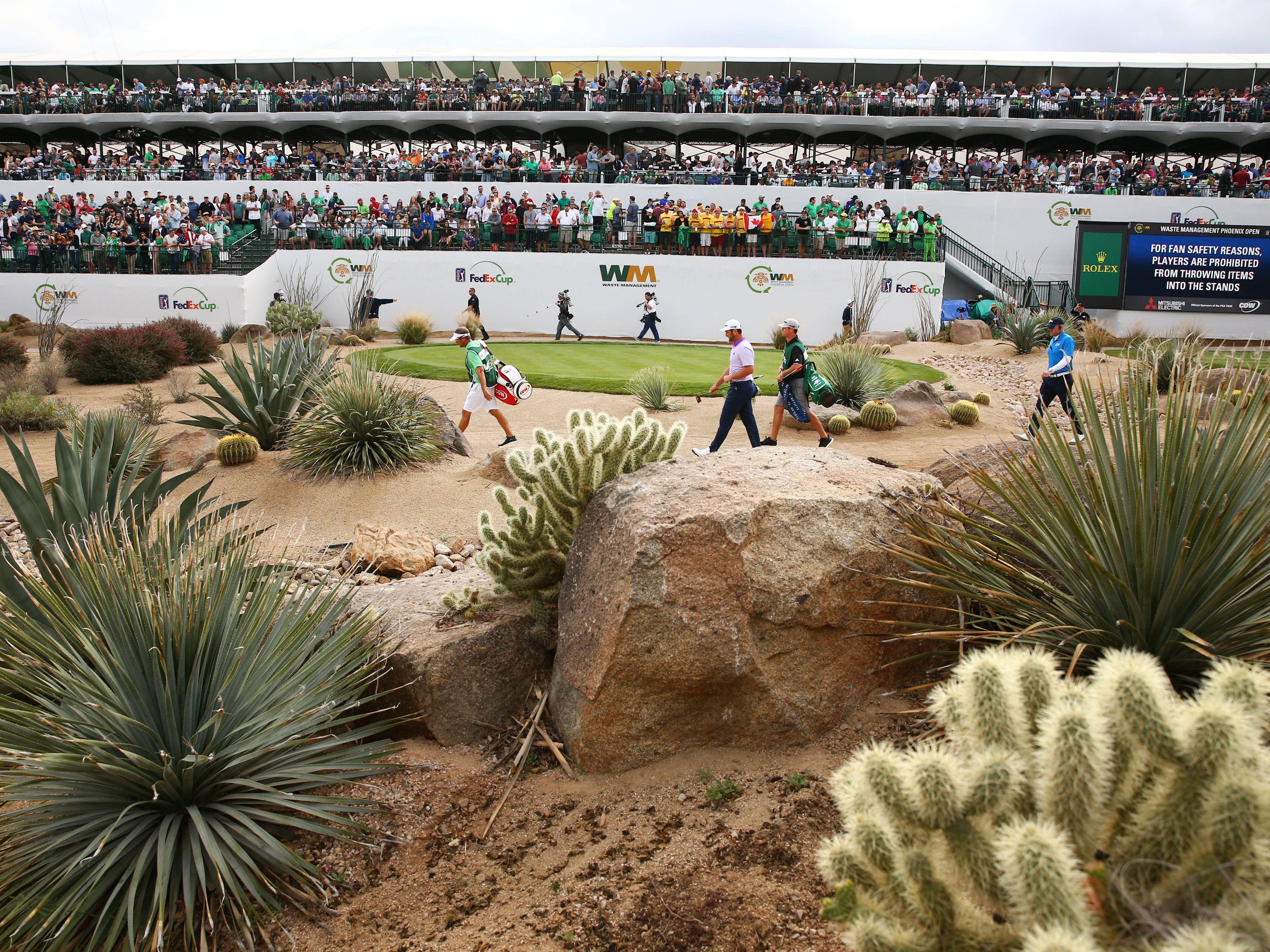 Jon Rahm walks off the ree box on the 16th hole during third round action on Feb. 2 during the Waste Management Phoenix Open at the TPC Scottsdale Stadium Course.