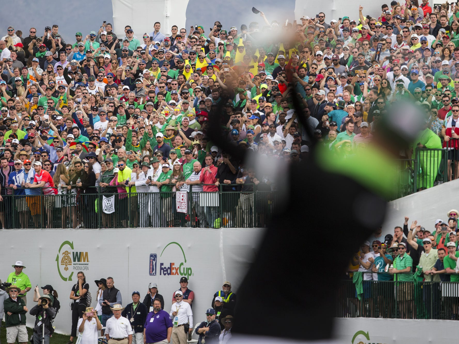 Fans watch as Justin Thomas tees off on the 16th hole during Round 3 of the Waste Management Phoenix Open on Saturday, Feb. 2, 2019, at TPC Scottsdale in Scottsdale, Ariz.