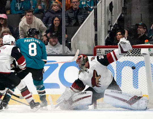 San Jose Sharks center Joe Pavelski (8) scores a goal past Arizona Coyotes goaltender Darcy Kuemper during the second period of an NHL hockey game in San Jose, Calif., Saturday, Feb. 2, 2019.
