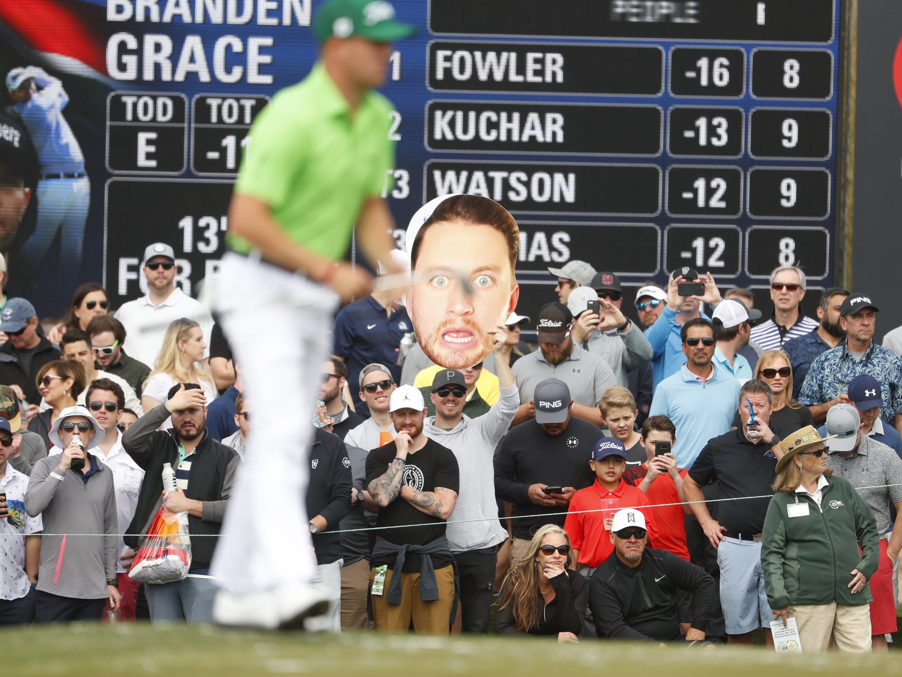 A Branden Grace cutout head sits near the 9th green during the third round of the Waste Management Phoenix Open at TPC Scottsdale in Scottsdale, Ariz. on February 2, 2019.