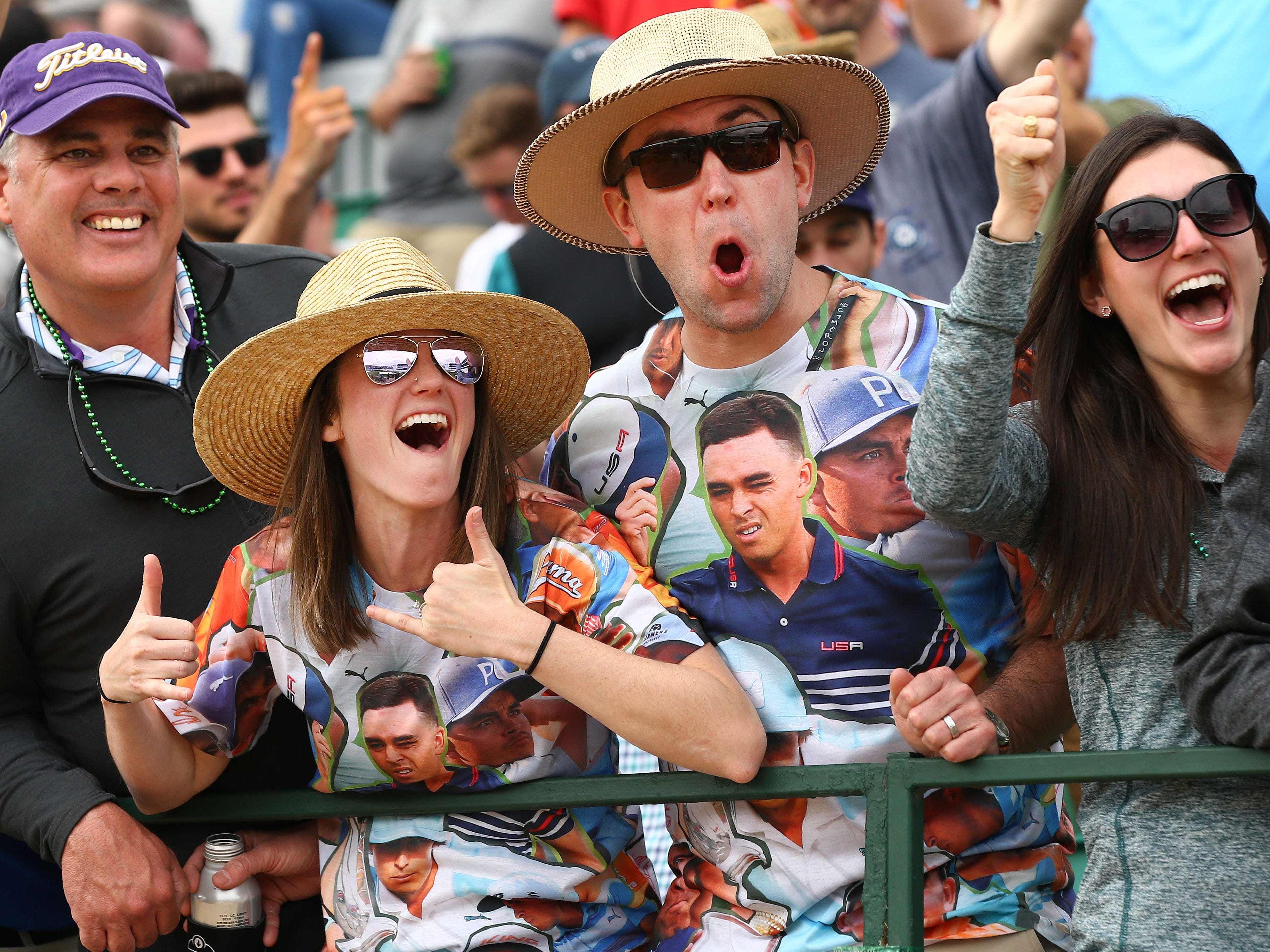 Anna and Patrick Stutler from Dallas, Texas wear Rickie Fowler outfits on the 16th hole during third round action on Feb. 2 during the Waste Management Phoenix Open at the TPC Scottsdale Stadium Course.