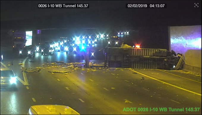 An overturned produce truck forced a closure of Interstate 10 westbound at the tunnel near downtown Phoenix.