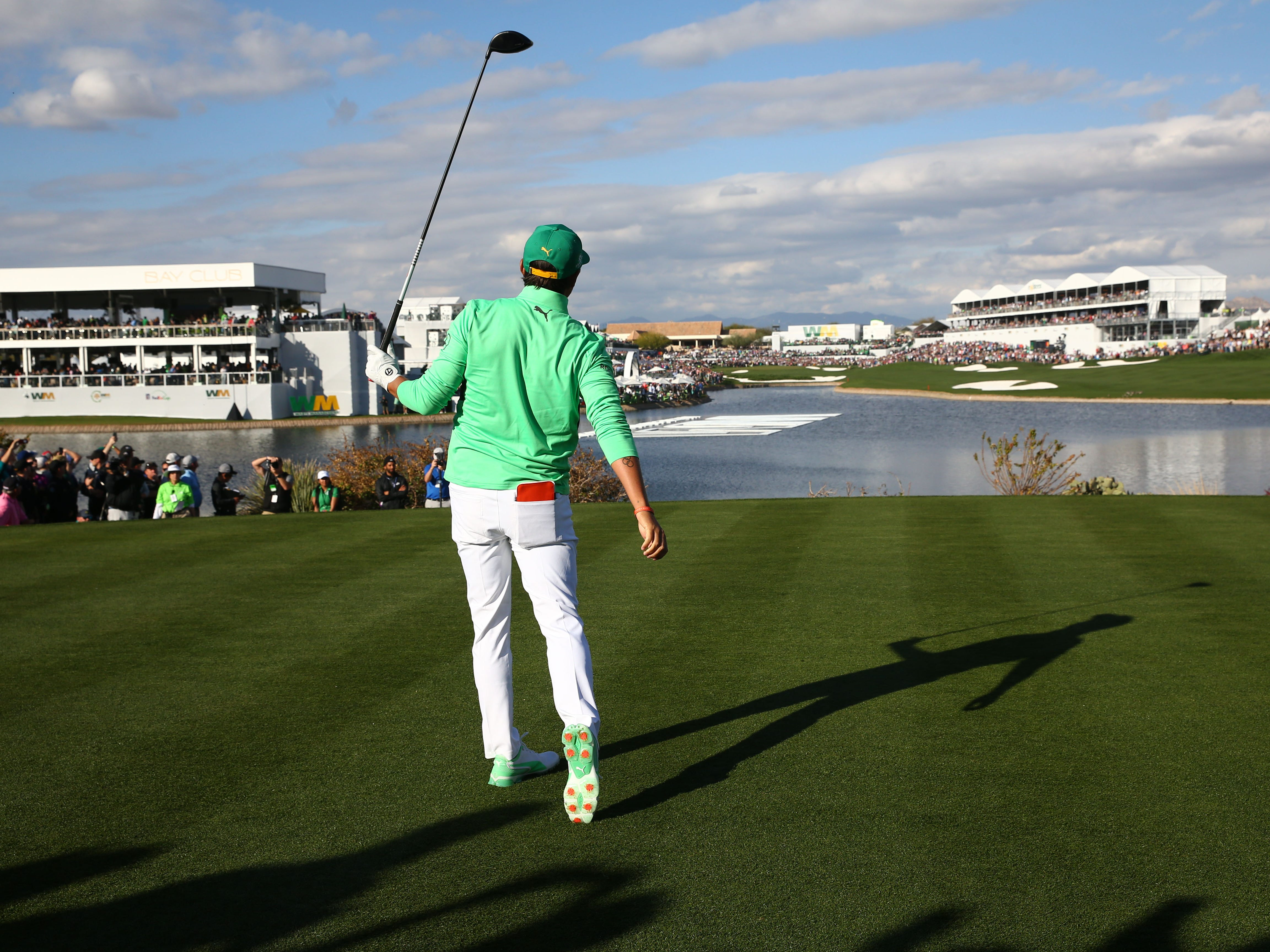 Rickie Fowler hits his drive into a bunker on the 18th hole during third round action on Feb. 2 during the Waste Management Phoenix Open at the TPC Scottsdale Stadium Course.