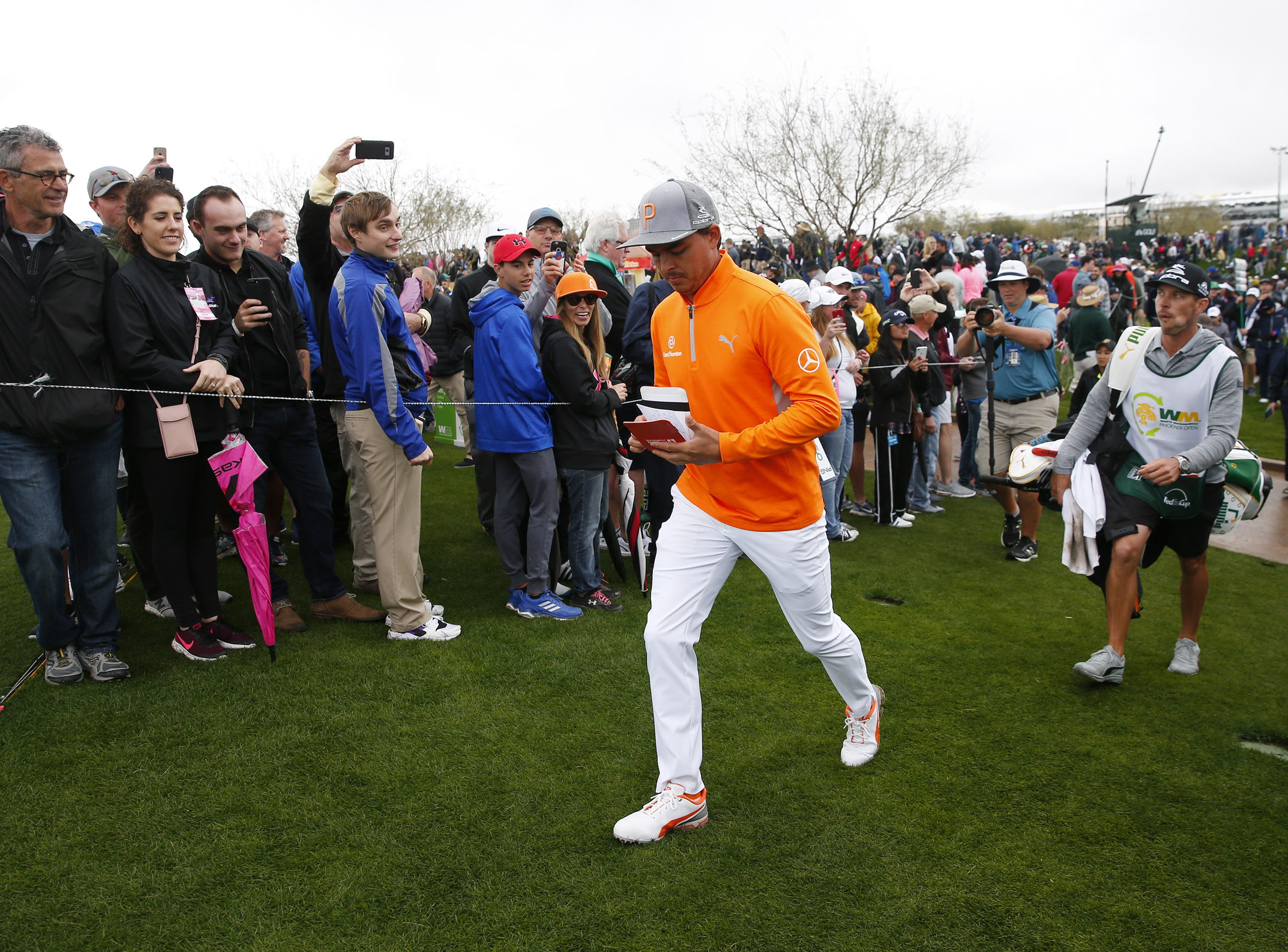 Rickie Fowler walks to the ninth tee box during the final round of the Waste Management Phoenix Open at the TPC Scottsdale Feb. 3, 2019.
