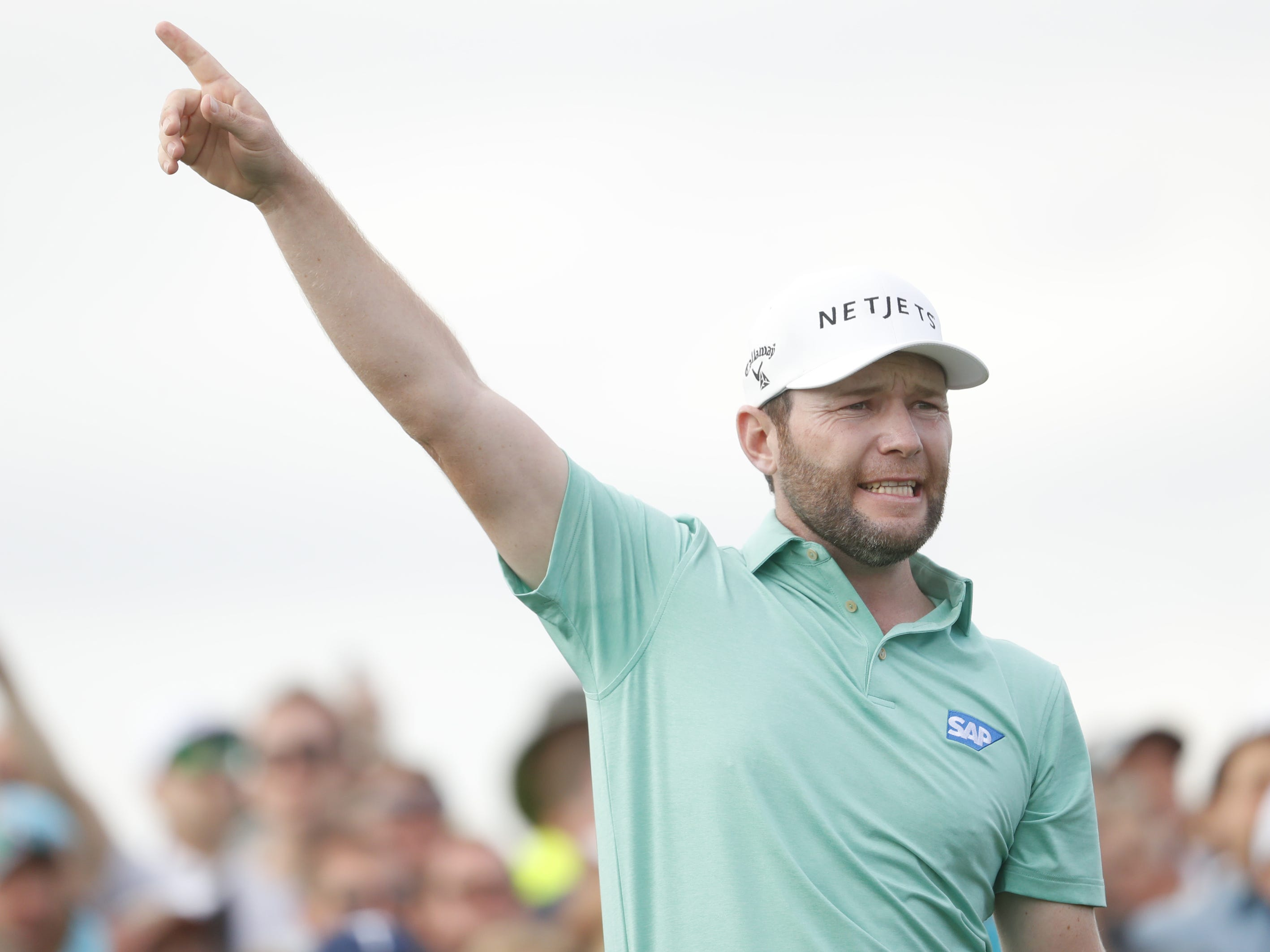Branden Grace points to his right after a tee shot on the 15th hole during the third round of the Waste Management Phoenix Open at TPC Scottsdale in Scottsdale, Ariz. on February 2, 2019.