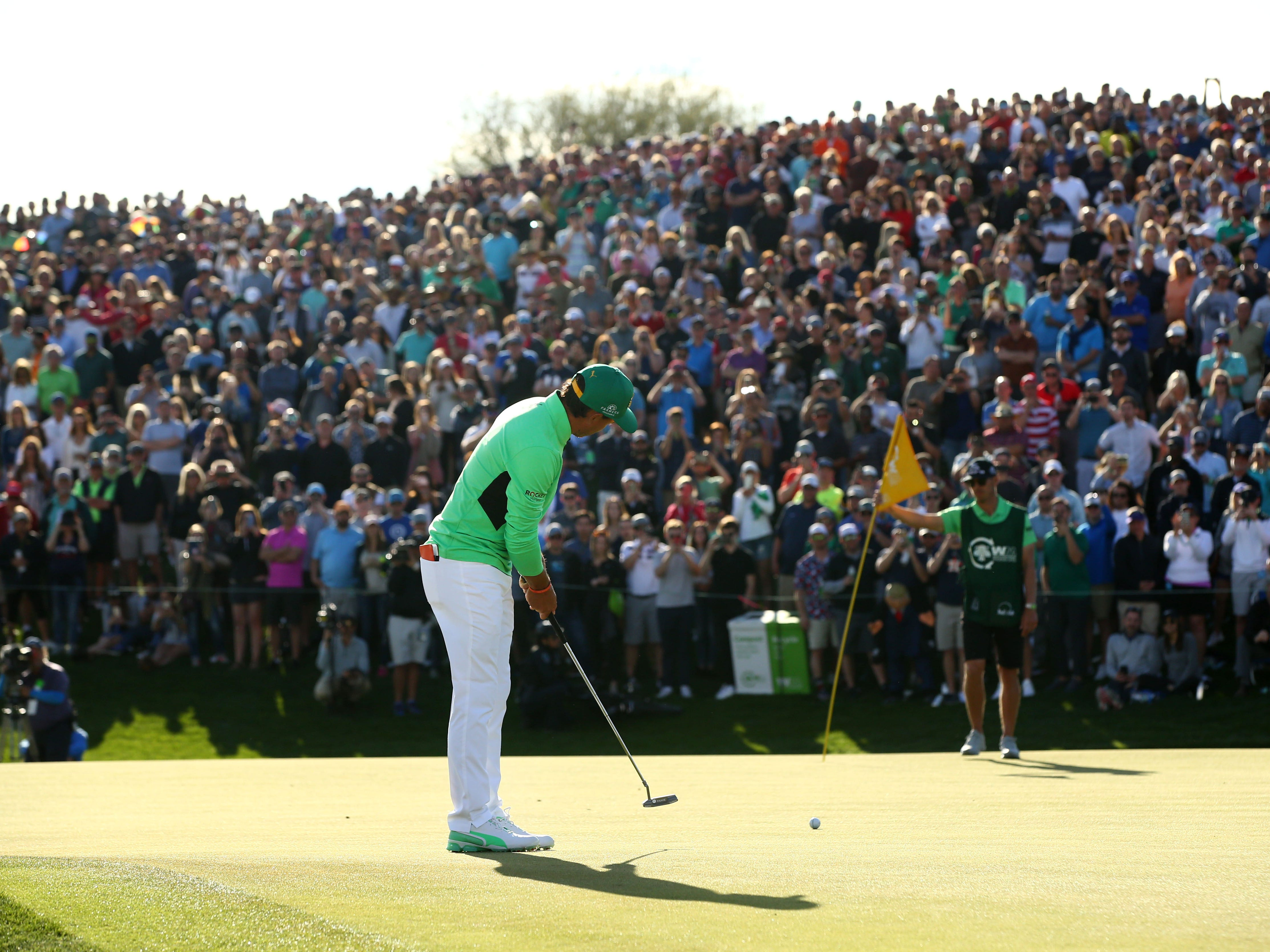 Rickie Fowler misses his birdie putt on the 18th hole during third round action on Feb. 2 during the Waste Management Phoenix Open at the TPC Scottsdale Stadium Course.