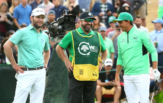 Brandon Grace (left) with his caddie Craig Connelly laughs with Rickie Fowler on the 7th tee box on Saturday.