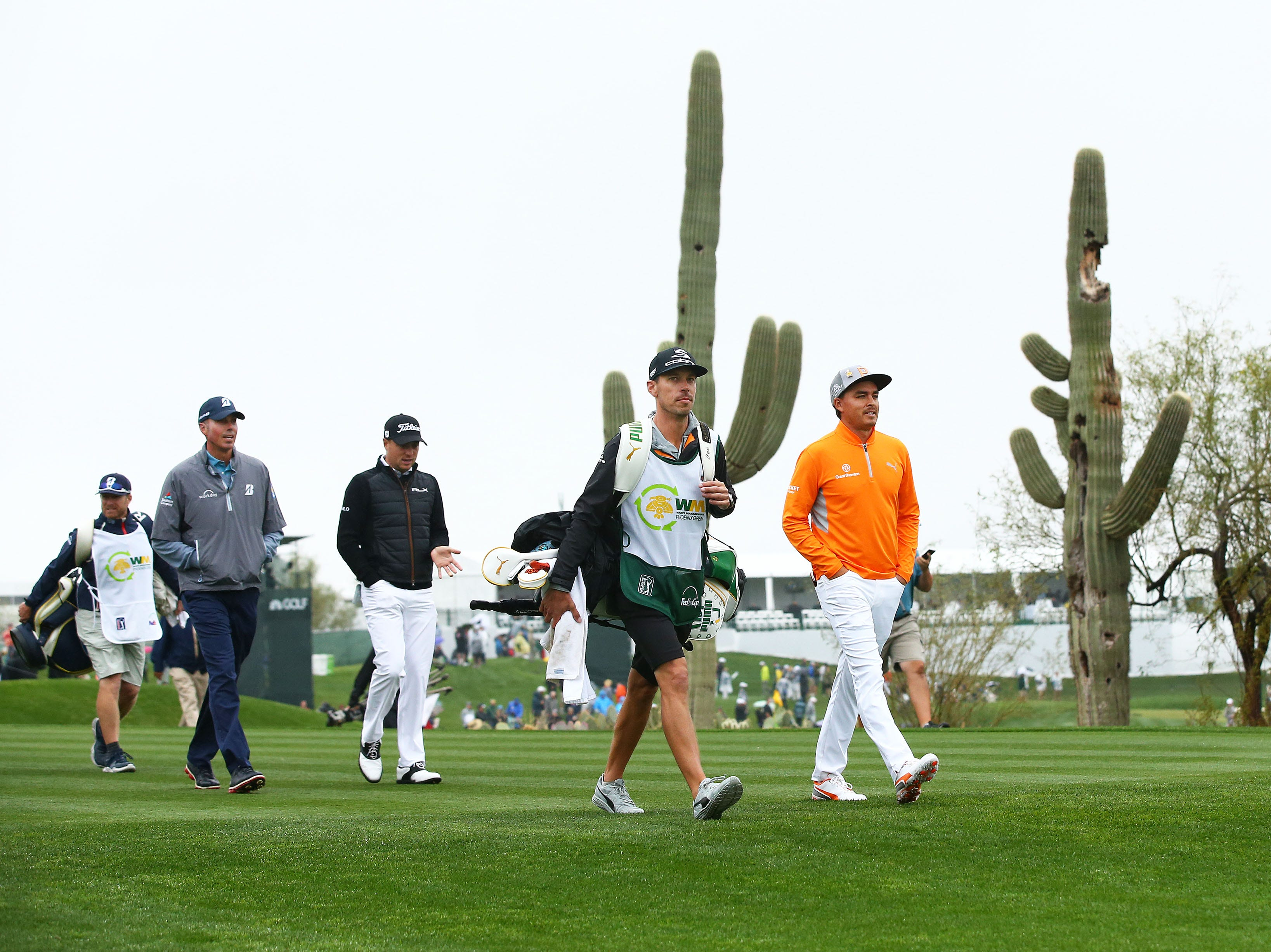 Rickie Fowler, Justin Thomas and Matt Kuchar walk-off the first tee box during final round action on Feb. 3 during the Waste Management Phoenix Open at the TPC Scottsdale Stadium Course.