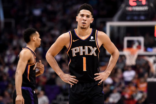 Feb 2, 2019: Phoenix Suns guard Devin Booker (1) reacts on the court in the first half against the Atlanta Hawks at Talking Stick Resort Arena.