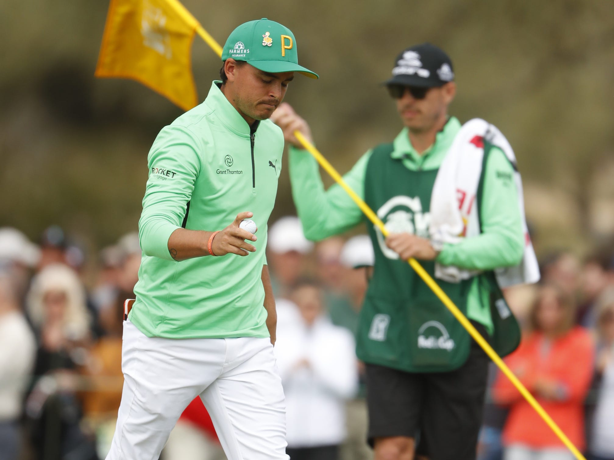 Rickie Fowler makes a putt on the 9th hole during the third round of the Waste Management Phoenix Open at TPC Scottsdale in Scottsdale, Ariz. on February 2, 2019.