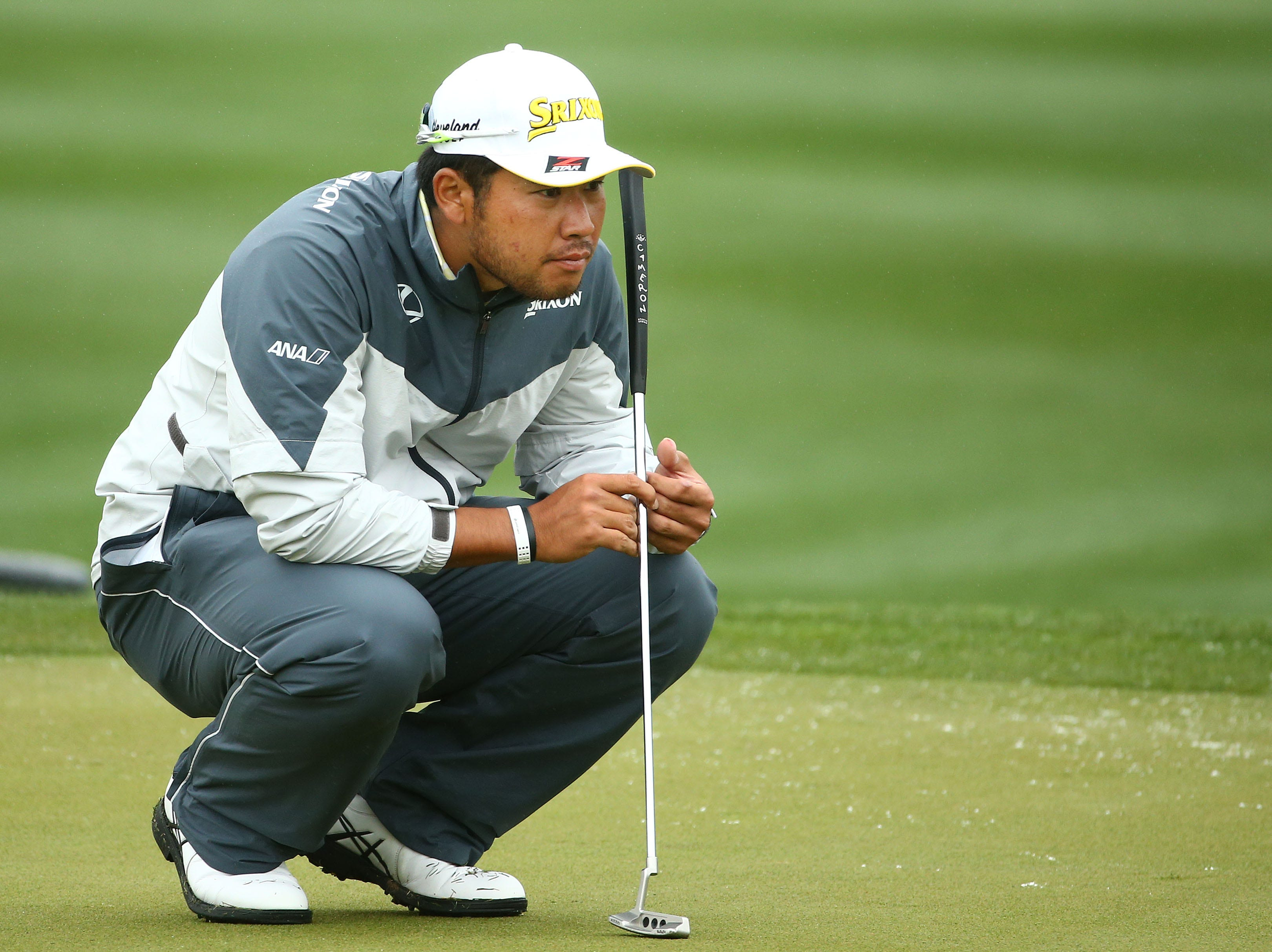 Hideki Matsuyama looks at his putt on the 6th green during final round action on Feb. 3 during the Waste Management Phoenix Open at the TPC Scottsdale Stadium Course.