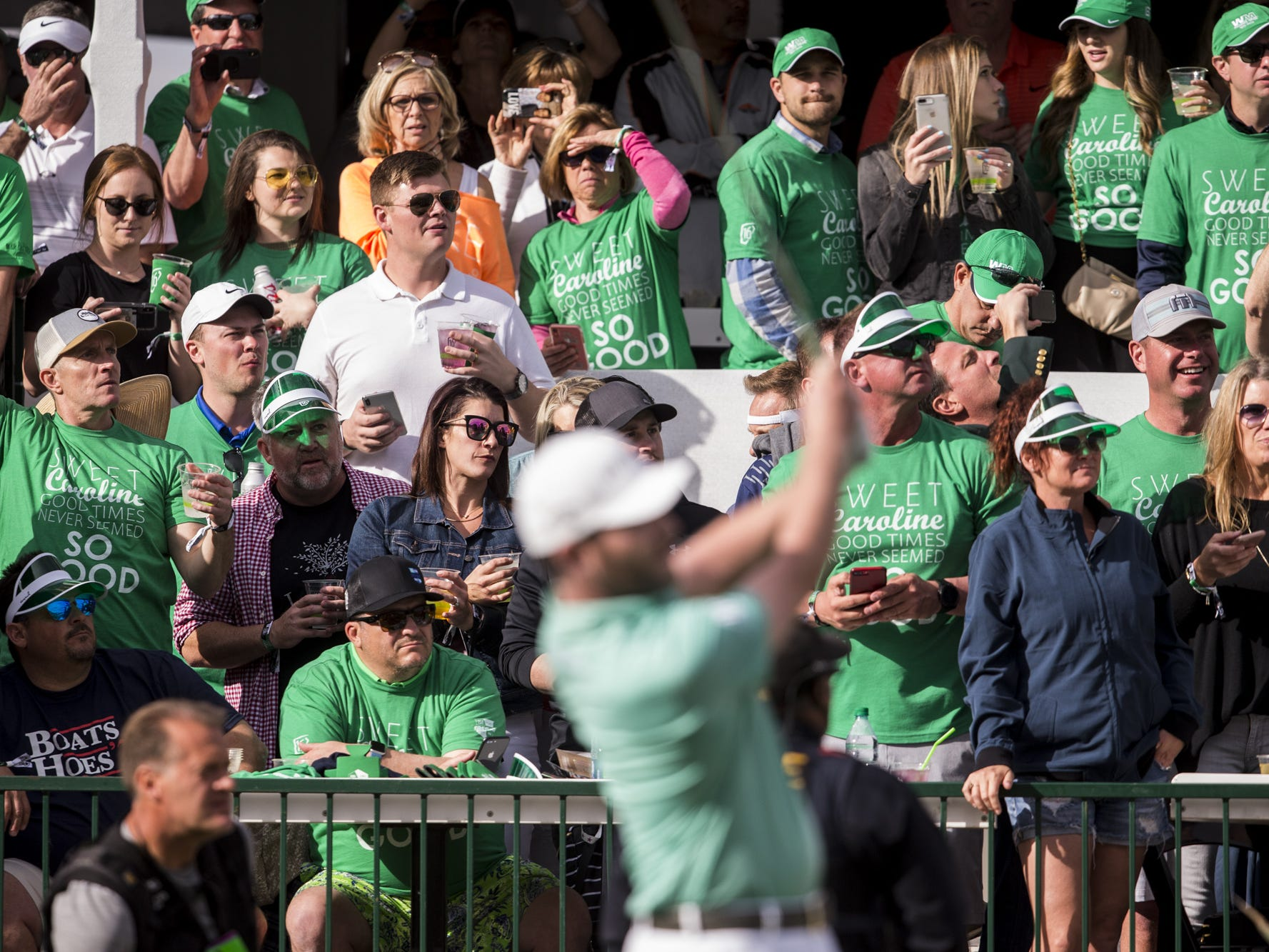 Fans watch as Branden Grace tees off on the 16th hole during Round 3 of the Waste Management Phoenix Open on Saturday, Feb. 2, 2019, at TPC Scottsdale in Scottsdale, Ariz.