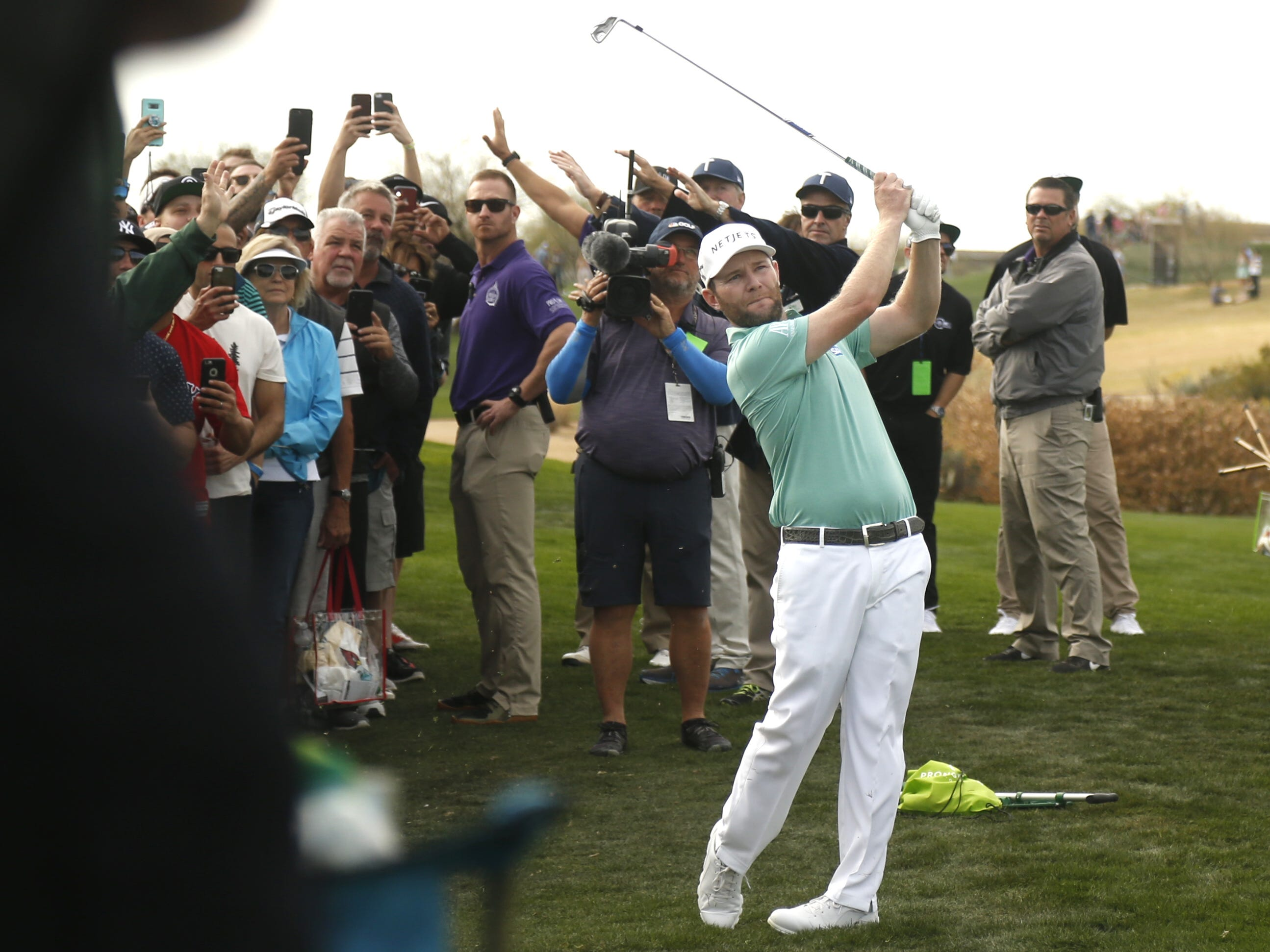 Branden Grace hits from a drop on the 15th hole during the third round of the Waste Management Phoenix Open at TPC Scottsdale in Scottsdale, Ariz. on February 2, 2019.