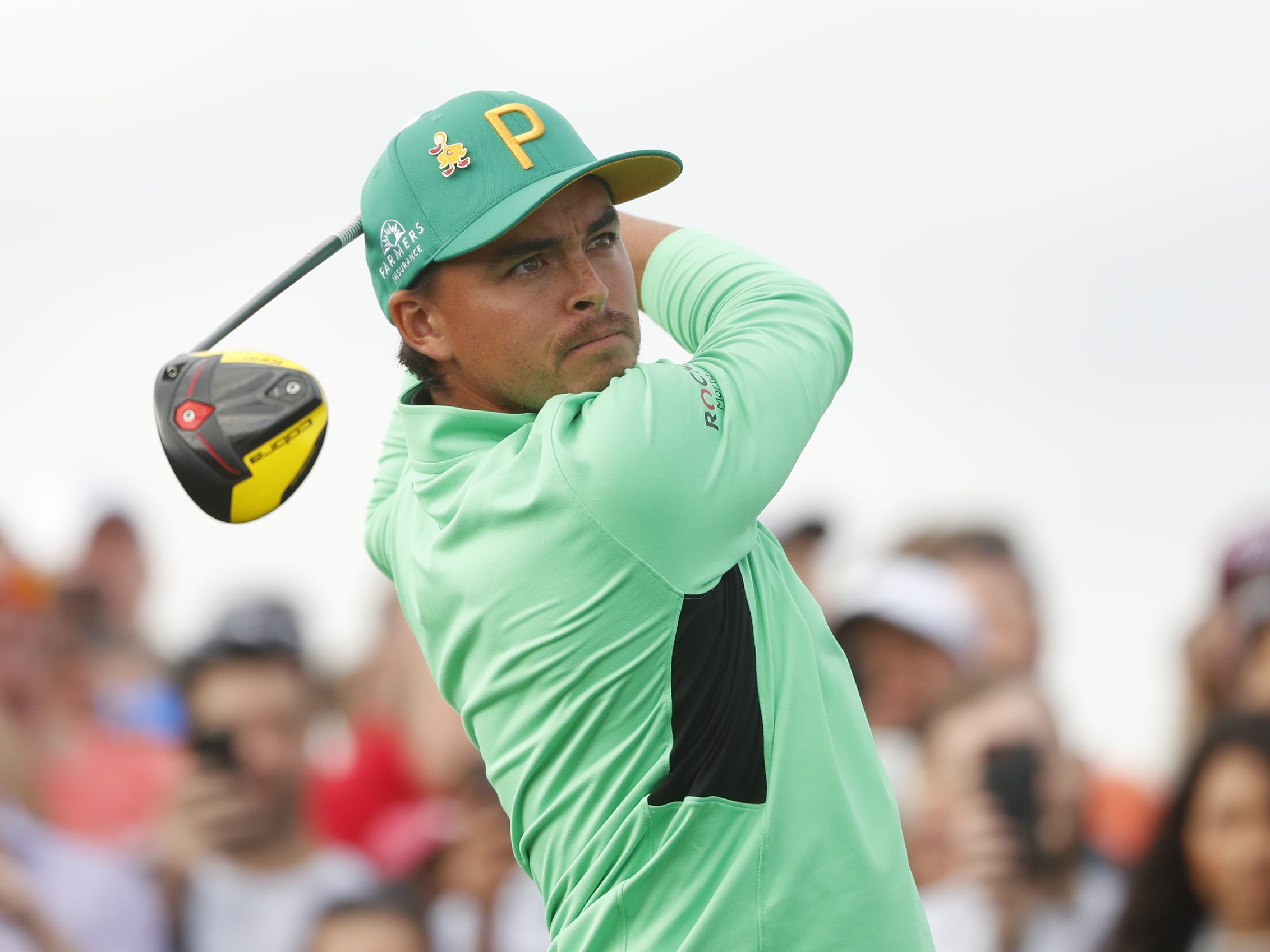 Rickie Fowler hits a tee shot on the 15th hole during the third round of the Waste Management Phoenix Open at TPC Scottsdale in Scottsdale, Ariz. on February 2, 2019.