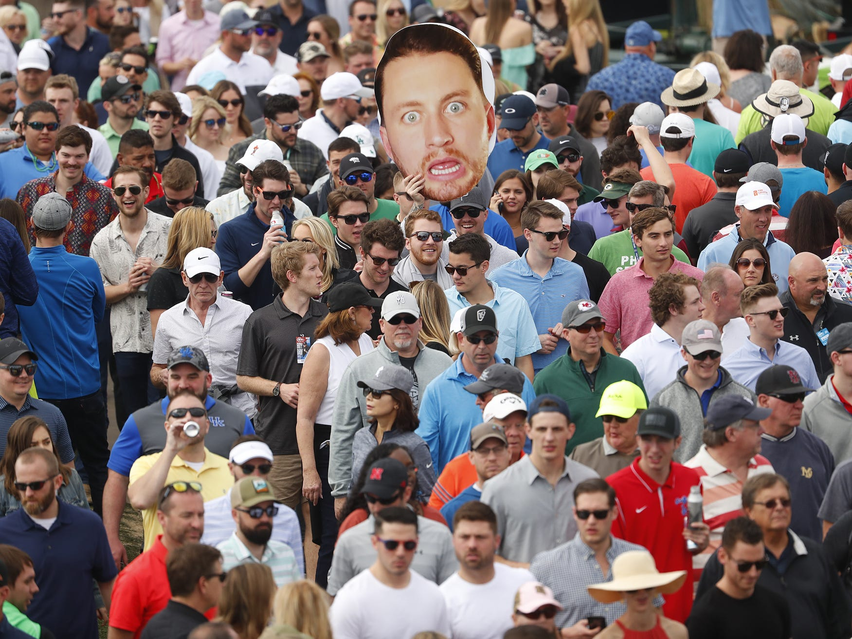 A cutout head seen above a mass crowd during the third round of the Waste Management Phoenix Open at TPC Scottsdale in Scottsdale, Ariz. on February 2, 2019.