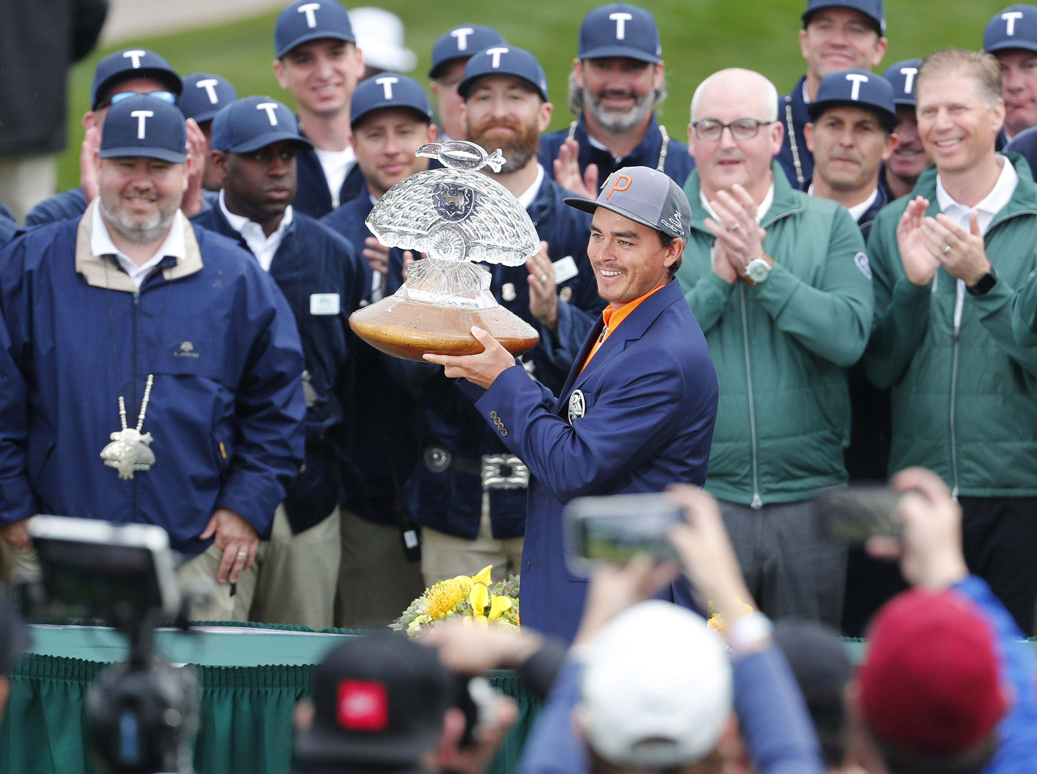 Rickie Fowler holds holds the trophy after winning the Waste Management Phoenix Open at the TPC Scottsdale Feb. 3, 2019.