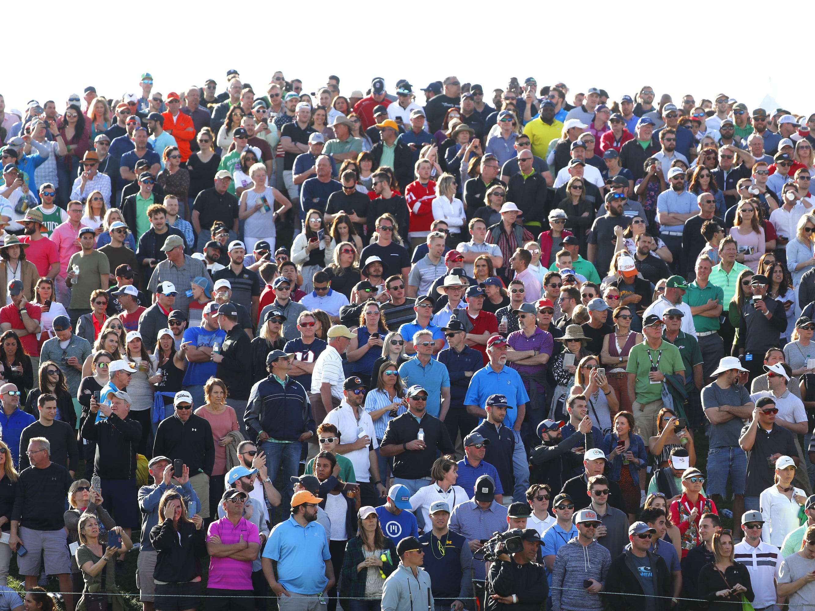 Fans watch Rickie Fowler take to the 18th green during the third round of the Waste Management Phoenix Open at TPC Scottsdale in Scottsdale, Ariz. on February 2, 2019.