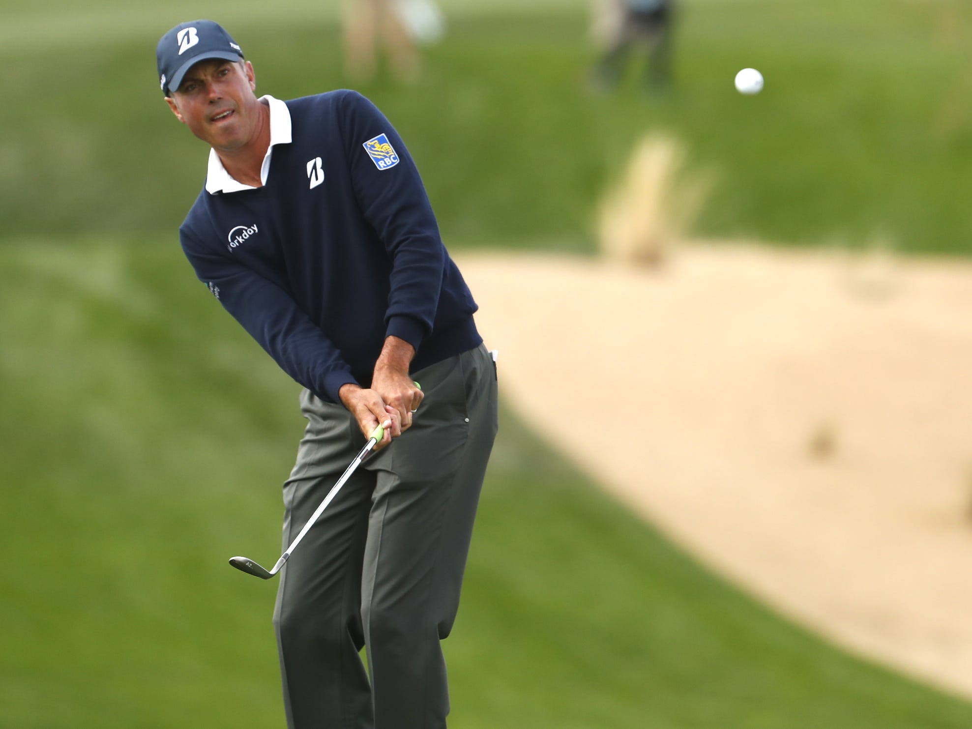 Matt Kuchar hits a chip shot on the 14th hole during the third round of the Waste Management Phoenix Open at TPC Scottsdale in Scottsdale, Ariz. on February 2, 2019.
