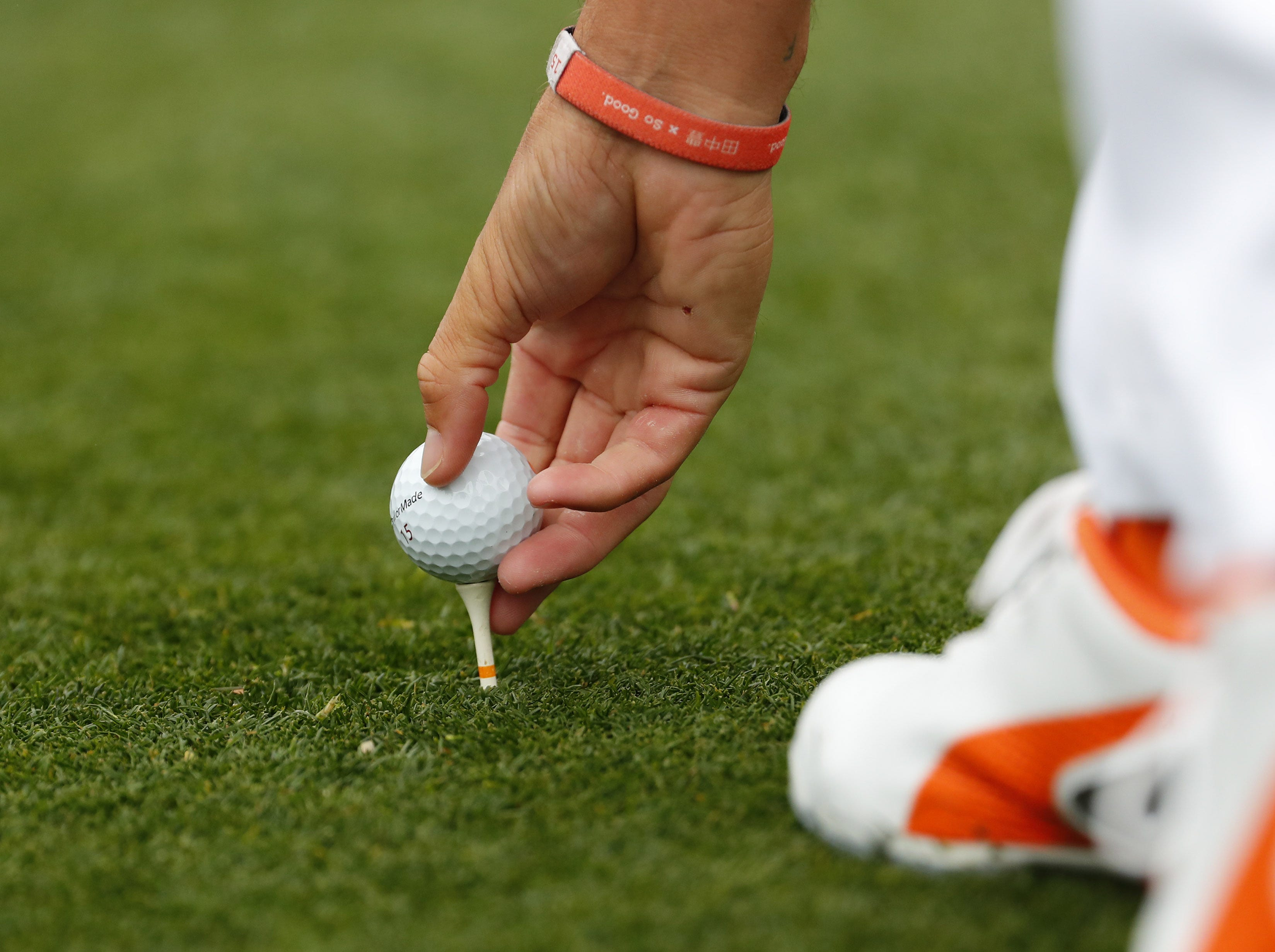 Rickie Fowler tees his ball up on the third hole during the final round of the Waste Management Phoenix Open at the TPC Scottsdale Feb. 3, 2019.