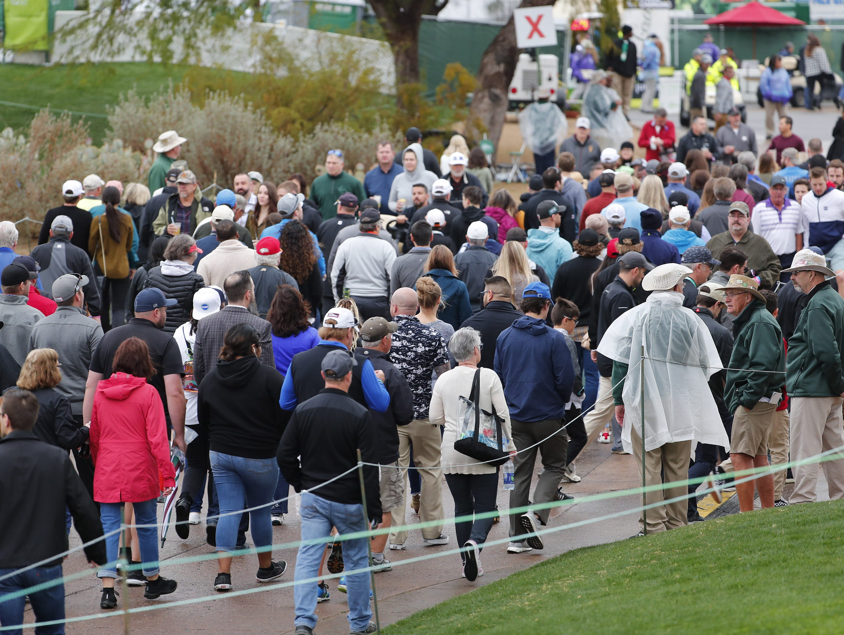 Fans make their way along the 10th hole during the final round of the Waste Management Phoenix Open at the TPC Scottsdale Feb. 3, 2019.