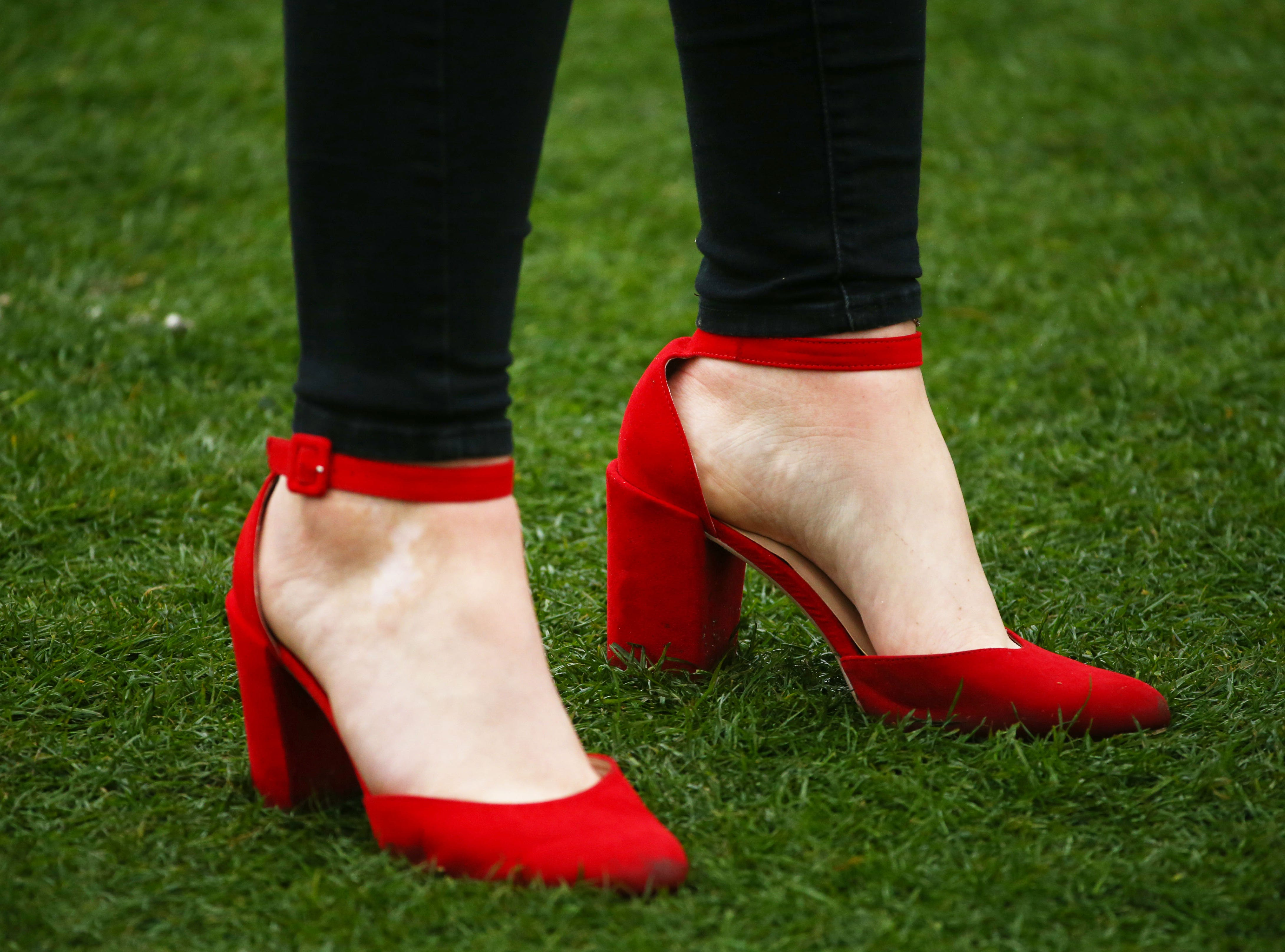 A spectator wears red heels at the 9th green during final round action on Feb. 3 during the Waste Management Phoenix Open at the TPC Scottsdale.