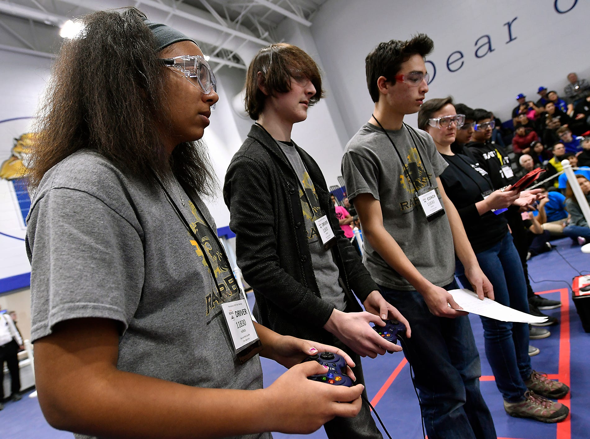 Zowie Murray, left, Reese Rulevich and Brandon Chen, right of the Red Lion High School team rorBots, maneuver their robot while competing in the Rover Ruckus robotics tournament at Penn State York, Sunday, February 3, 2019. John A. Pavoncello photo