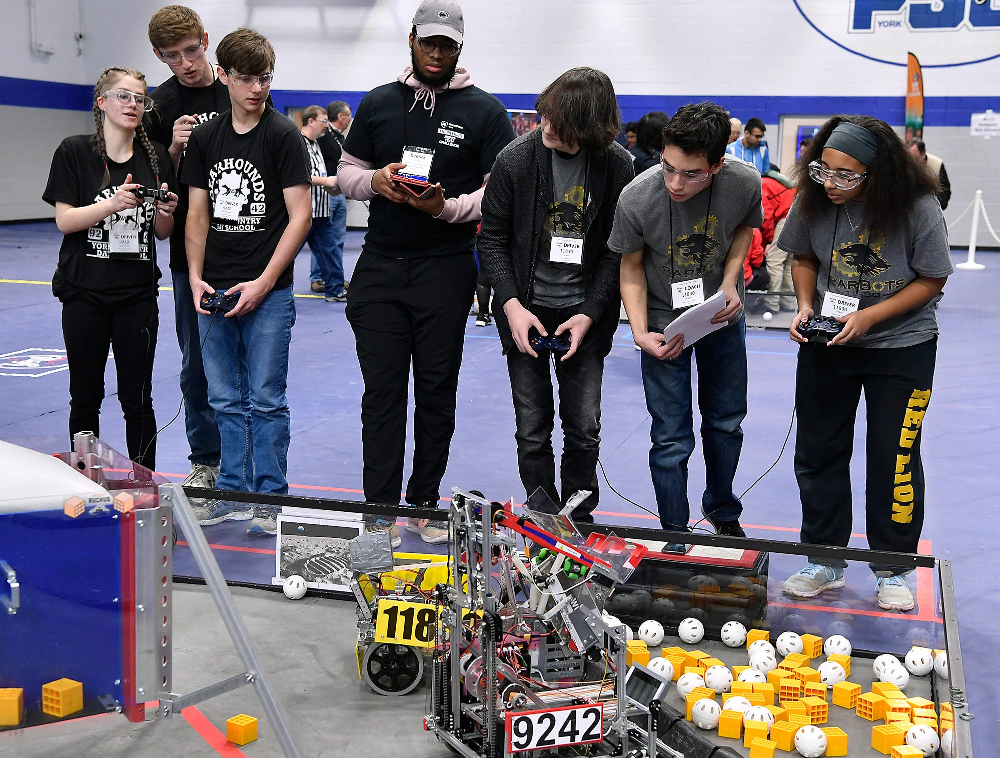 York Country Day School GearHound team Juliet Jacob, lef, Sean Evans and Christian Morino work with Red Lion High rarBots team members Reese Rulevich, Brandon Chen and Zowie Murray, right, during a round of the Rover Ruckus robotics tournament at Penn State York, Sunday, February 3, 2019. John A. Pavoncello photo