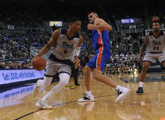 Tre'Shawn Thurman, left, and Nevada will enter the NCAA Tournament ranked 20th in both major national polls.