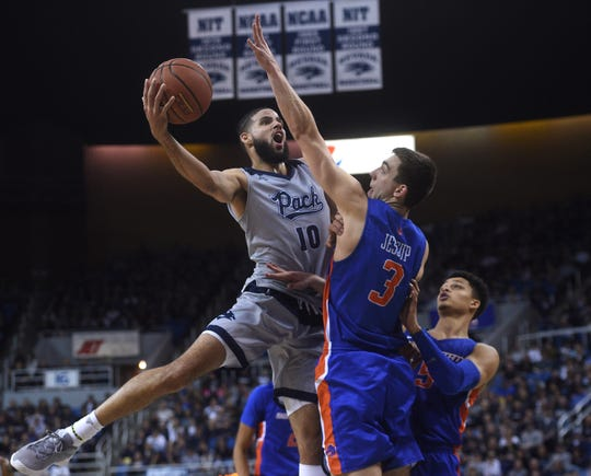 Nevada's Caleb Martin looks to get around Boise State's Justinian Jessup during Saturday's game at Lawlor Events Center.