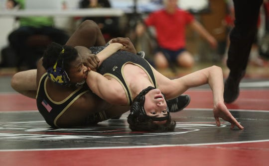 Rush-Henrietta's Mijid Refaai tries to stay off his back in the 120-pound title match against teammate Jayden Scott.