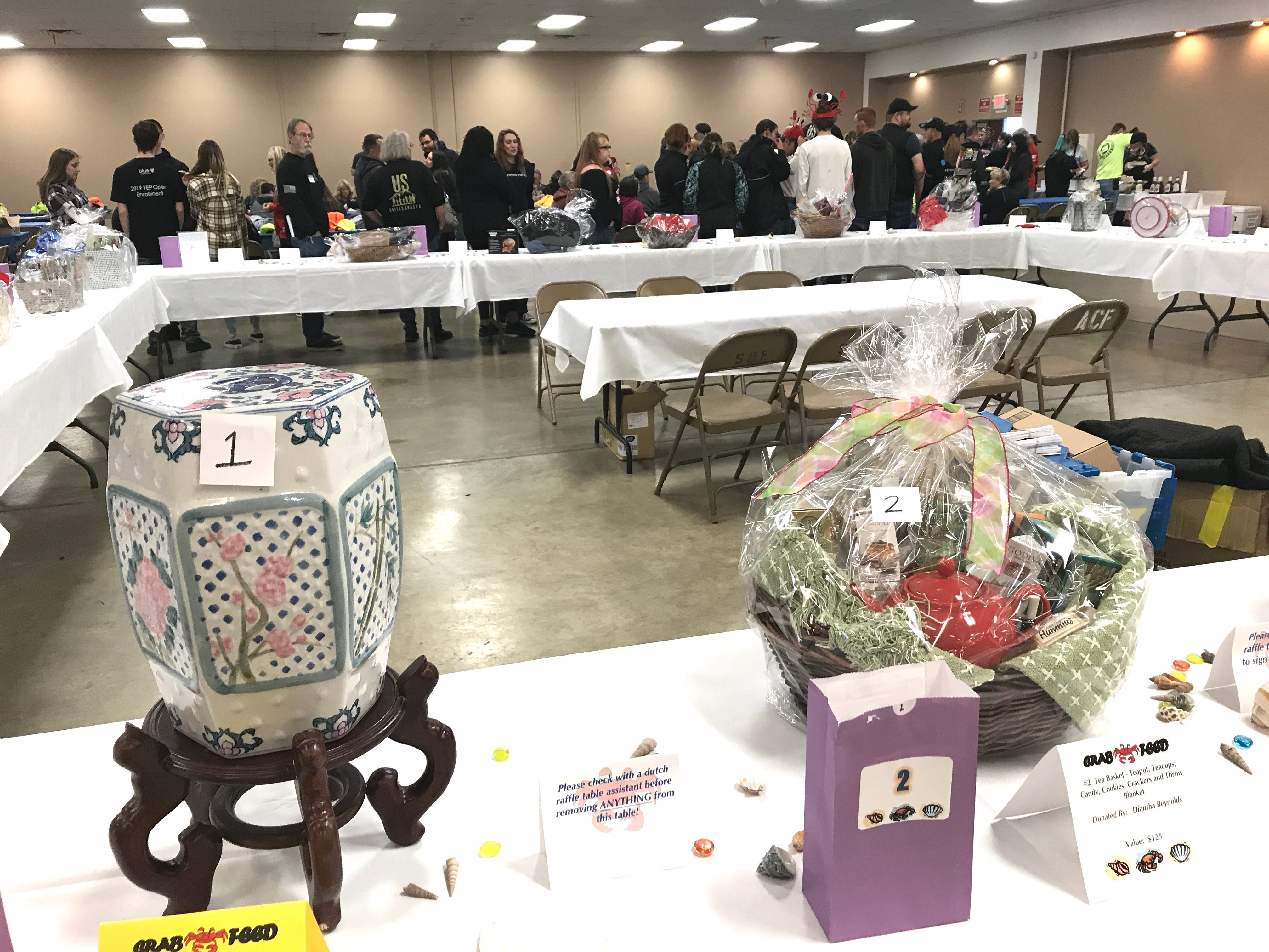 Auction items were on display as volunteers were served a meal prior to One SAFE Place's annual crab feed Saturday, Feb. 2, 2019, at the Shasta District Fair grounds in Anderson.