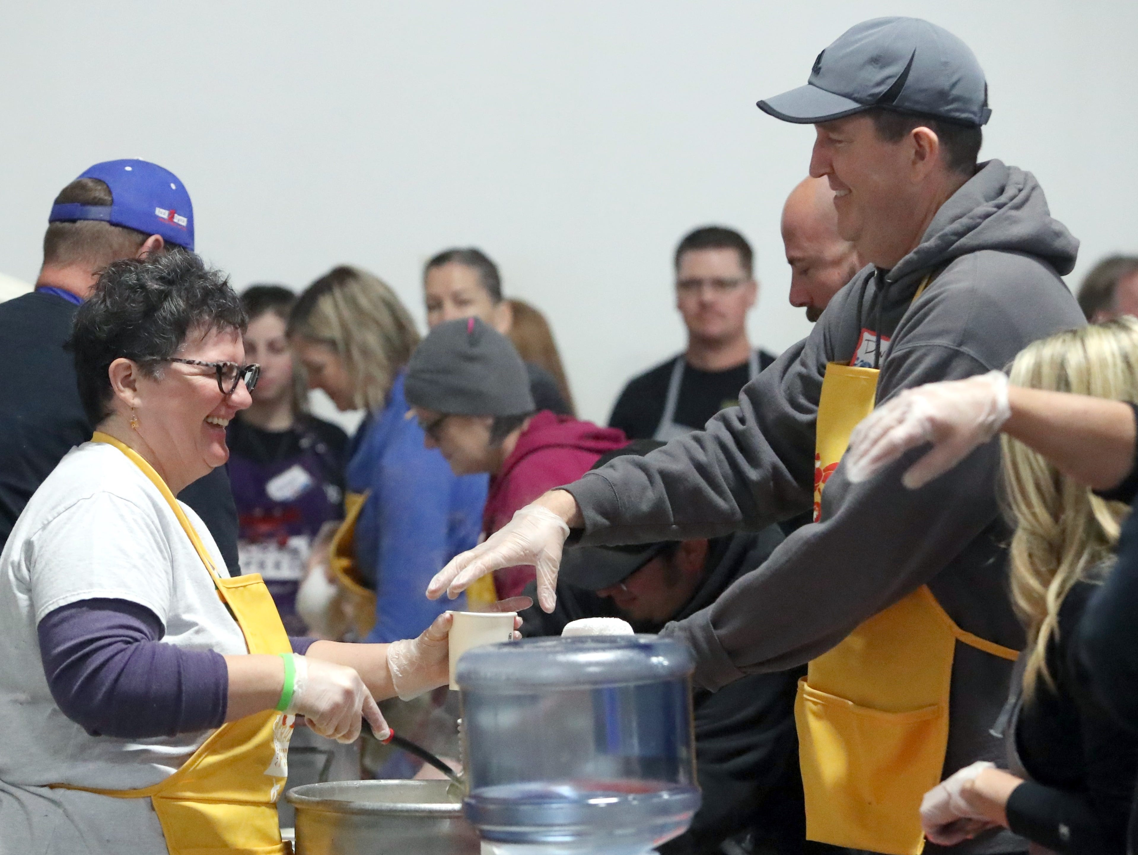 Helpers load up on the Anderson Rotary Club's clam chowder to serve to some 1,200 people at One SAFE Place's crab feed Saturday, Feb. 2, 2019, at the Shasta District Fair grounds in Anderson.