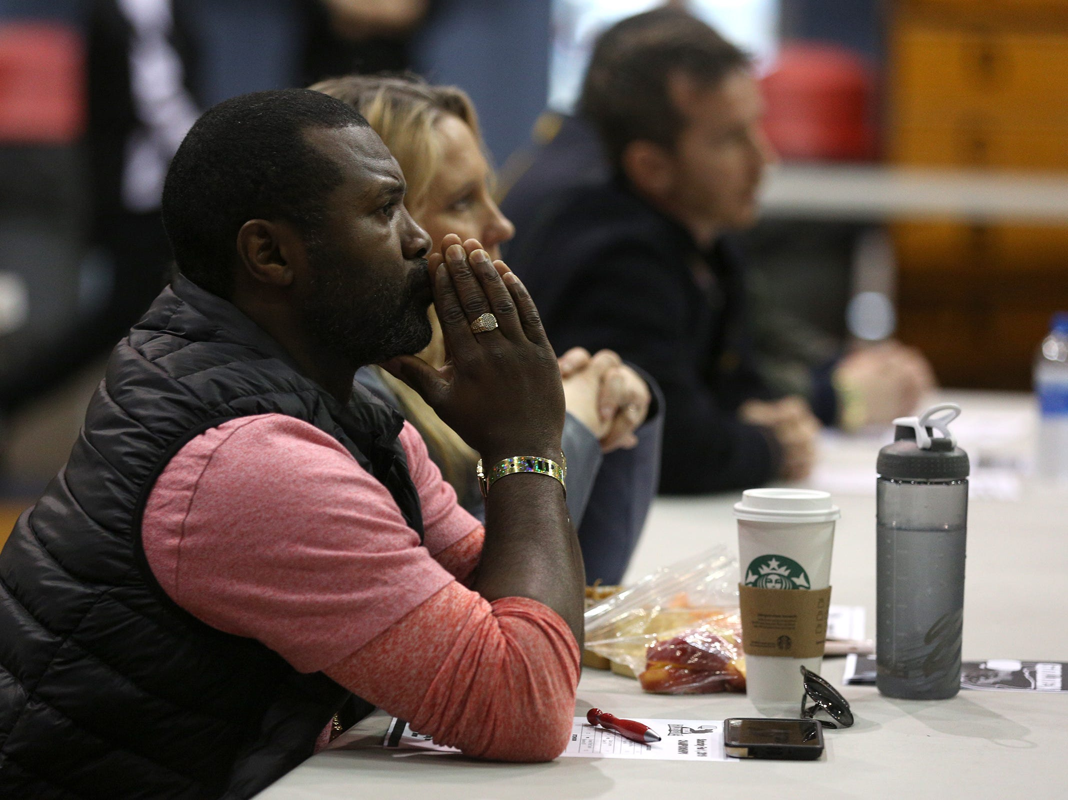 Steve Forbes, former IBF and USBA super featherweight champion, watches amateur boxers compete during the Oregon Golden Gloves championship matches at the Salem Armory on Saturday, Feb. 2, 2019.