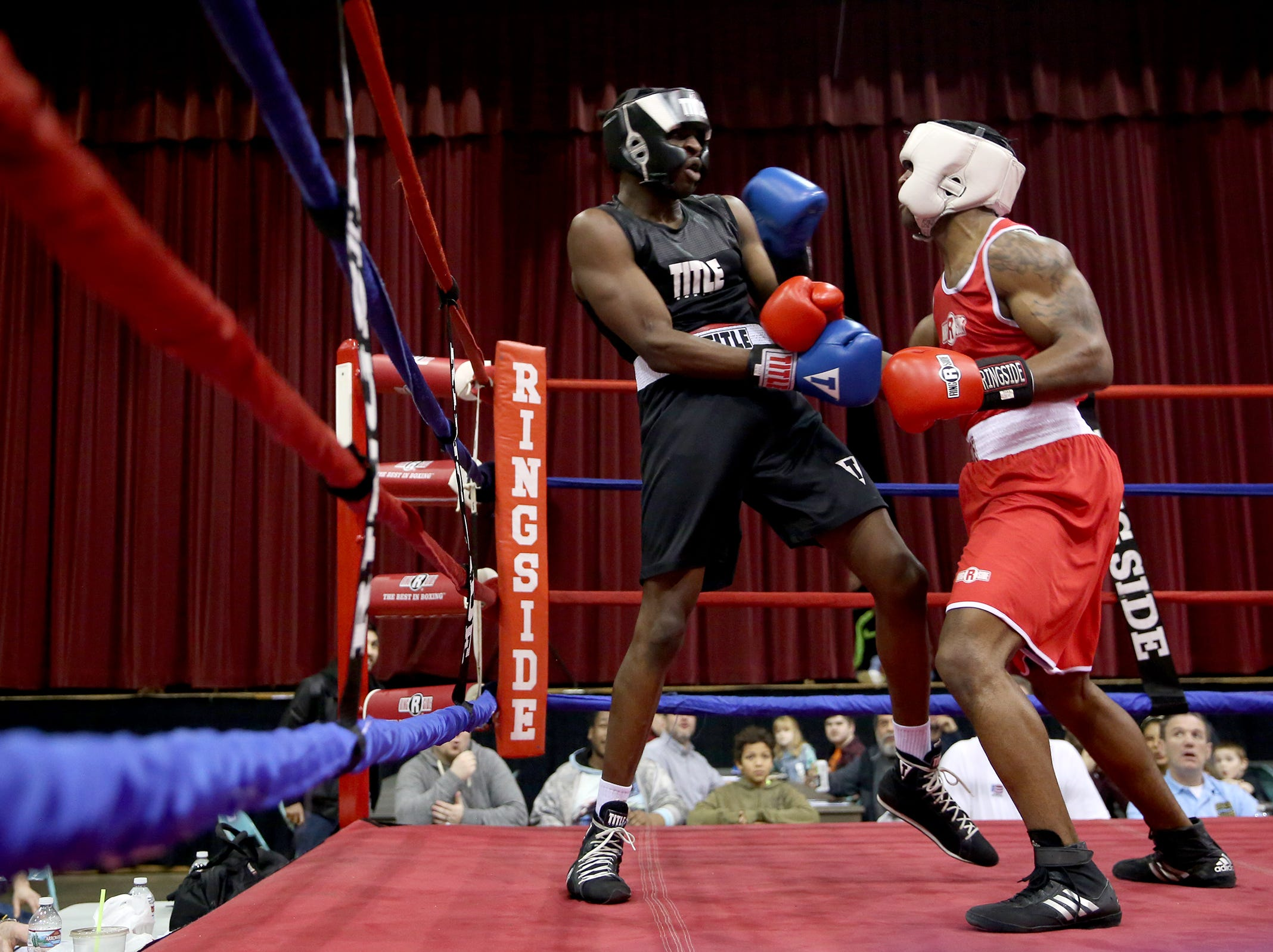 Xecareus Walker of Kent, Washington (left) takes on Michad McMillan of Tigard (right) in the first bout of the Oregon Golden Gloves championship matches at the Salem Armory on Saturday, Feb. 2, 2019.