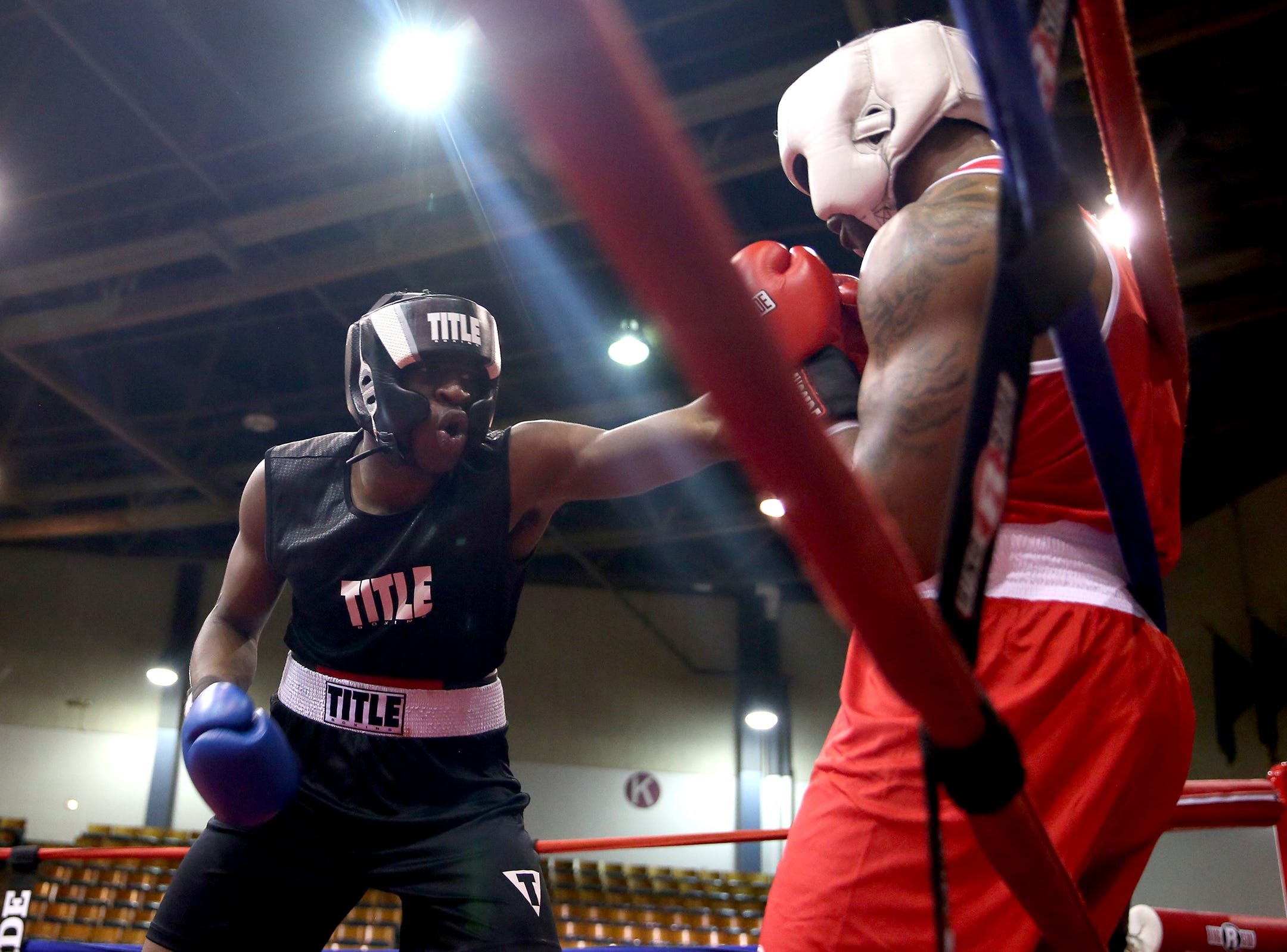 Xecareus Walker of Kent, Washington (left) takes a jab at Michad McMillan of Tigard (right) in the first bout of the Oregon Golden Gloves championship matches at the Salem Armory on Saturday, Feb. 2, 2019.
