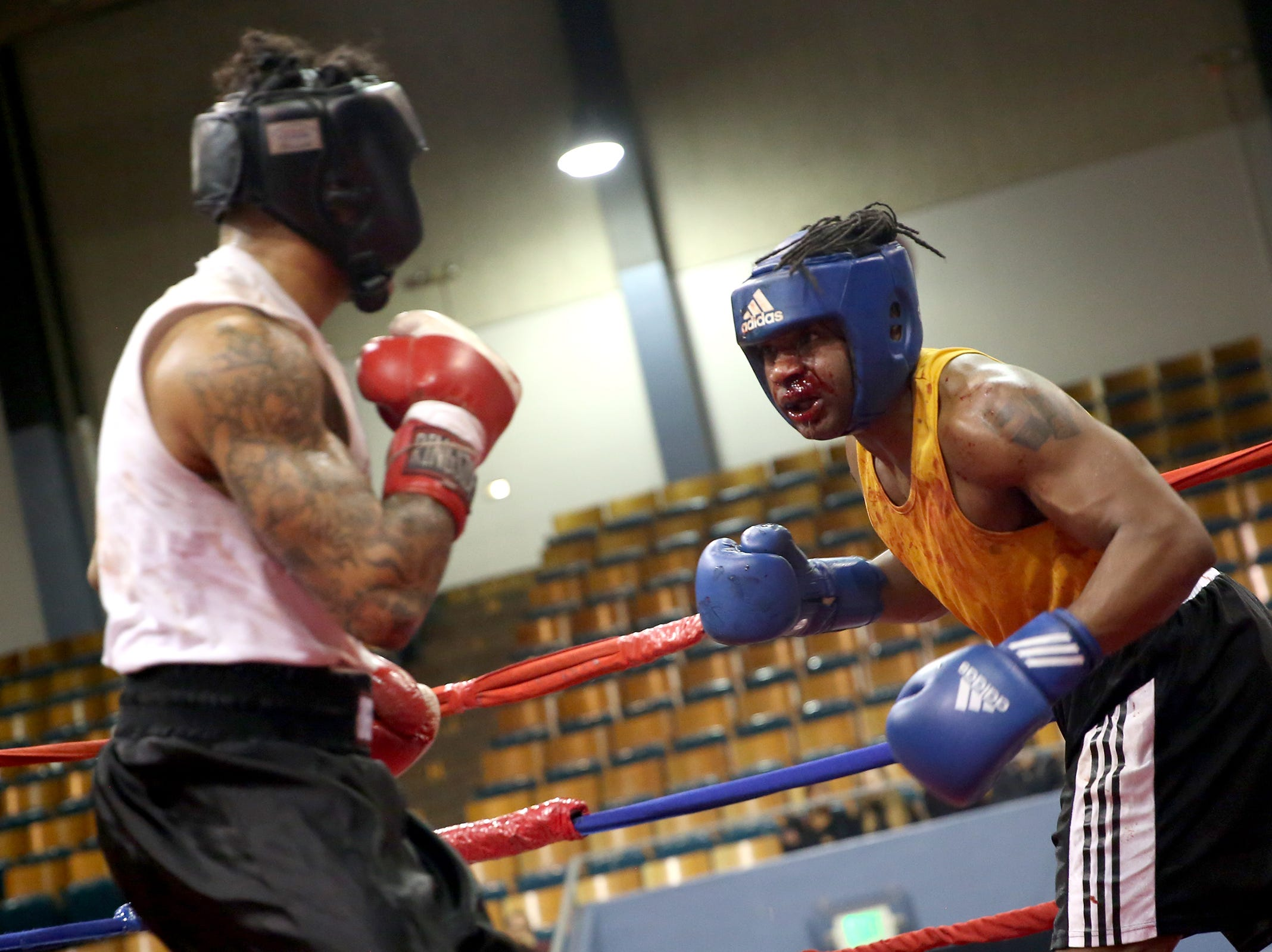 Joseph Aguilar (left) of Happy Valley takes on Terance Oddie of Vancouver (right) at the Oregon Golden Gloves championship matches at the Salem Armory on Saturday, Feb. 2, 2019.