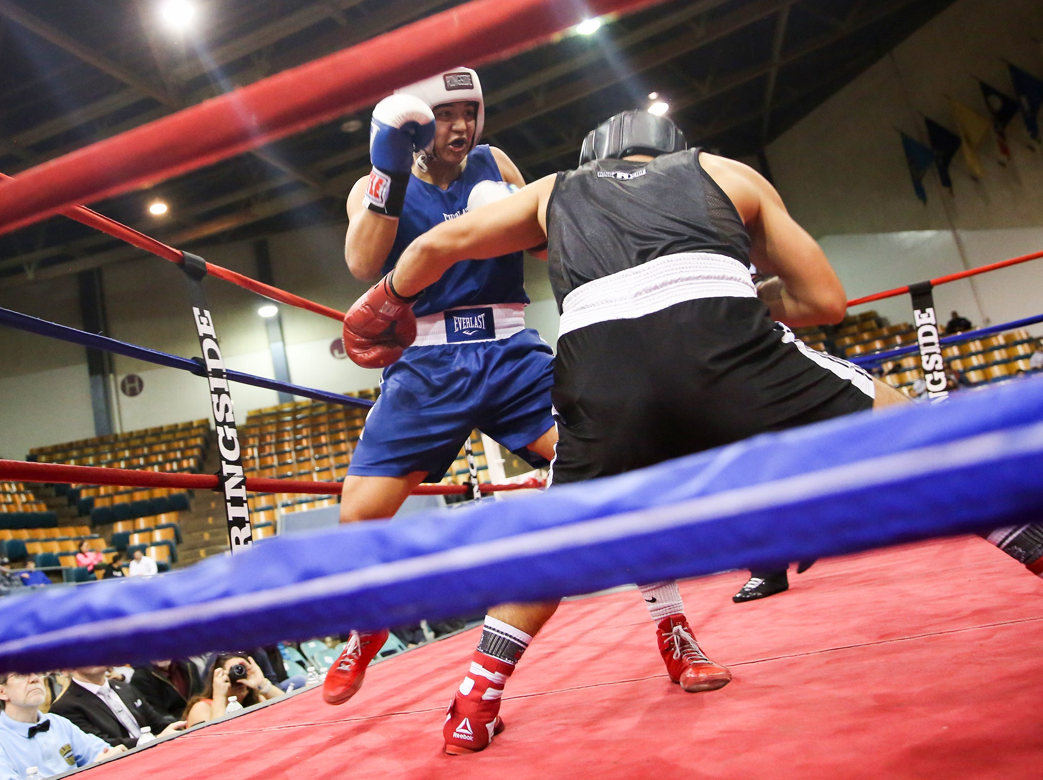 Omar Murillo of Salem takes on Eduard Ynez of Grehsam at the Oregon Golden Gloves championship matches at the Salem Armory on Saturday, Feb. 2, 2019.