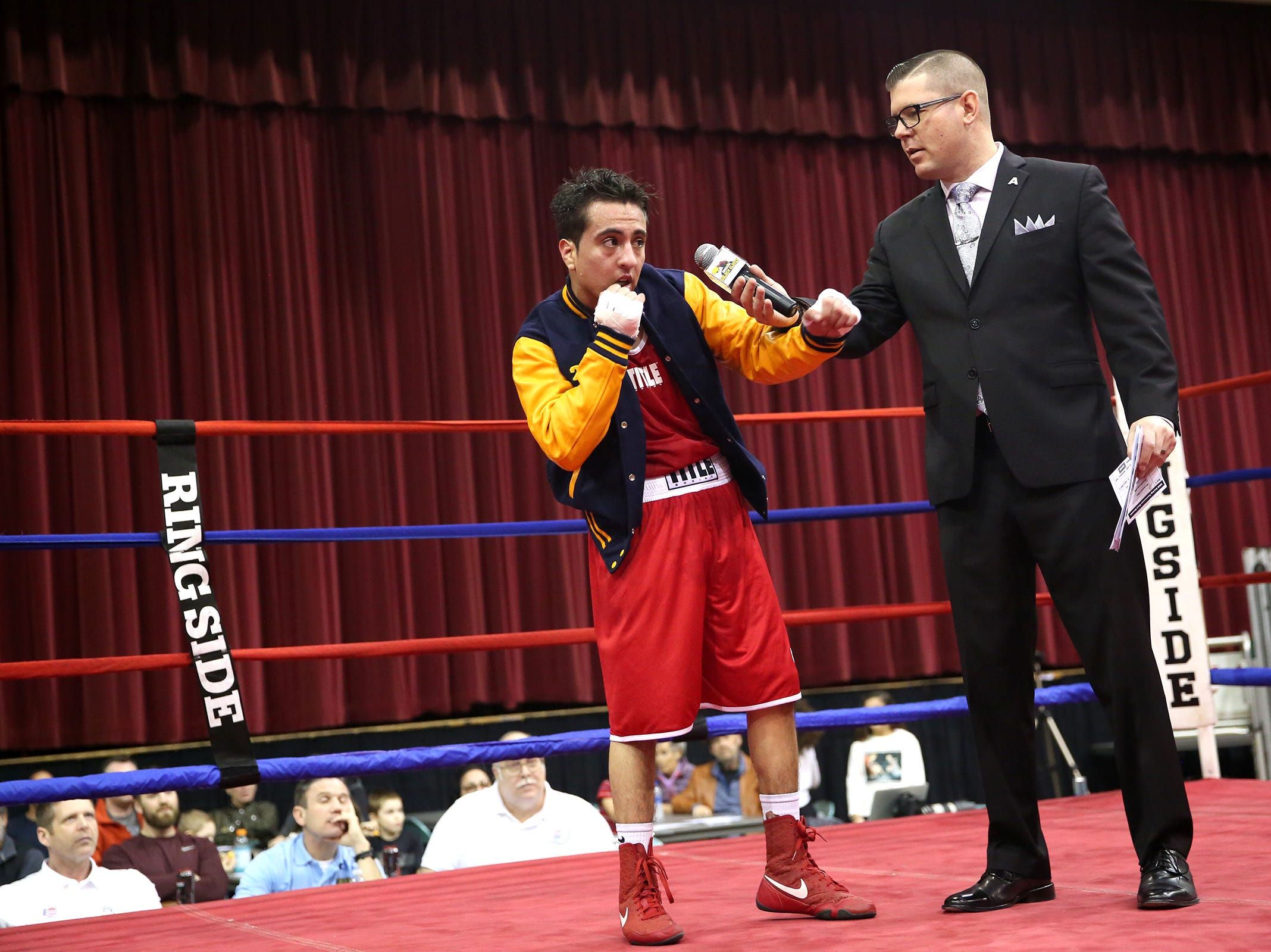 Jonathan Pena of Salem is pronounced victorious at the Oregon Golden Gloves championship matches at the Salem Armory on Saturday, Feb. 2, 2019.