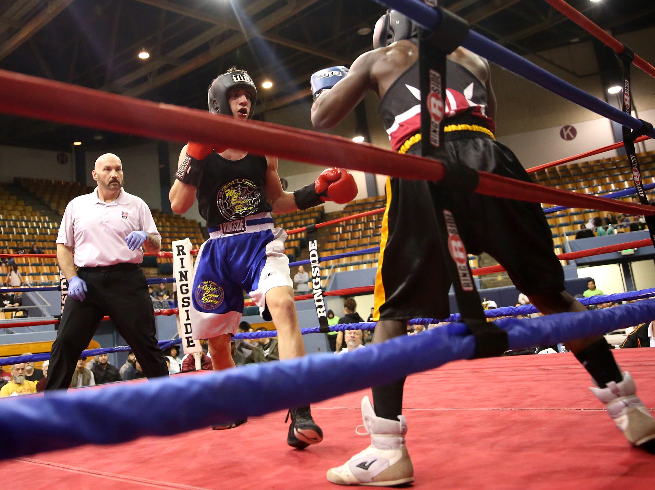 Anthony Cruz of Eugene takes on Ishmael Omulindi of Beaverton during the Oregon Golden Gloves championship matches at the Salem Armory on Saturday, Feb. 2, 2019.