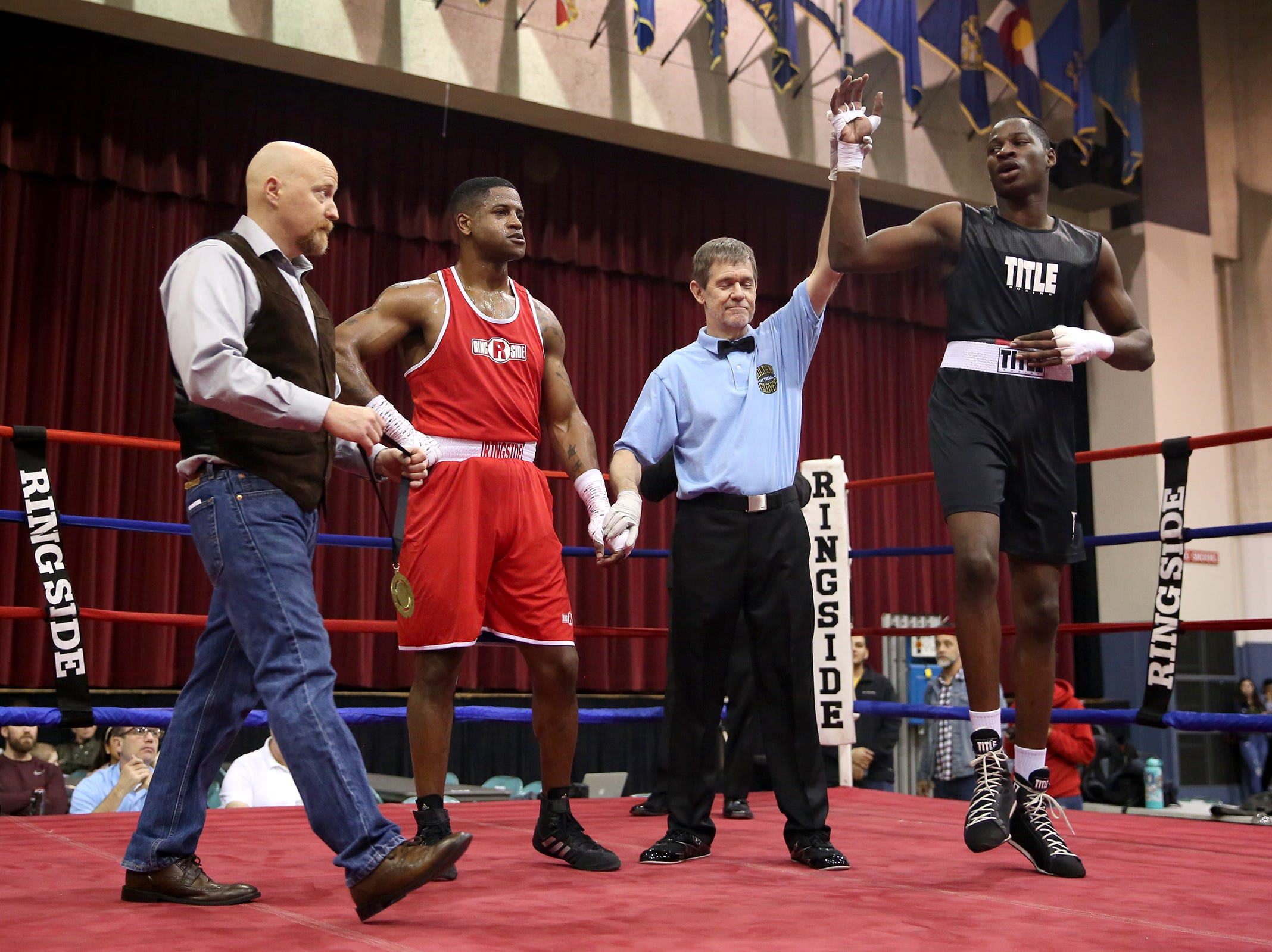 Xecareus Walker of Kent, Washington is declared winner against Michad McMillan of Tigard after their fight at the Oregon Golden Gloves championship matches at the Salem Armory on Saturday, Feb. 2, 2019.