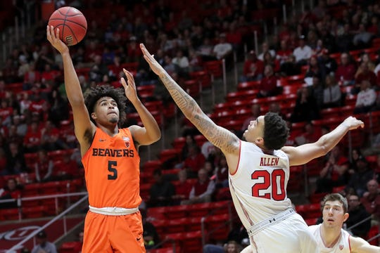 Oregon State guard Ethan Thompson (5) shoots the ball over Utah forward Timmy Allen (20) during the first half of an NCAA college basketball game, Saturday, Feb. 2, 2019, in Salt Lake City.