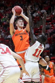 Oregon State forward Tres Tinkle (3) looks over the arms of Utah forward Both Gach (11) while shooting during the first half of an NCAA college basketball game Saturday, Feb. 2, 2019, in Salt Lake City.