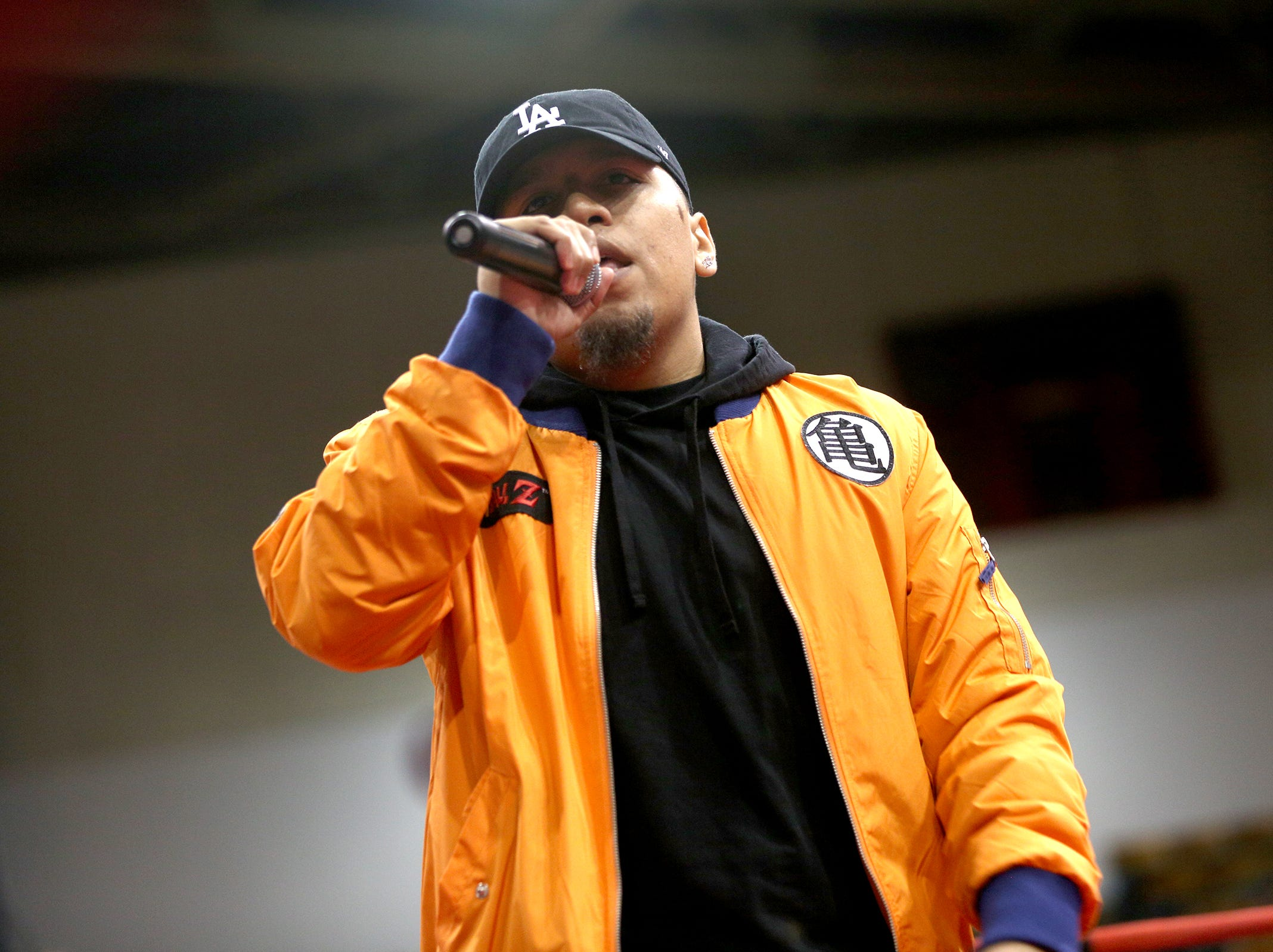 Salem rapper Kevin Gomez who goes by St. Alex performs during an intermission at the Oregon Golden Gloves championship matches at the Salem Armory on Saturday, Feb. 2, 2019.