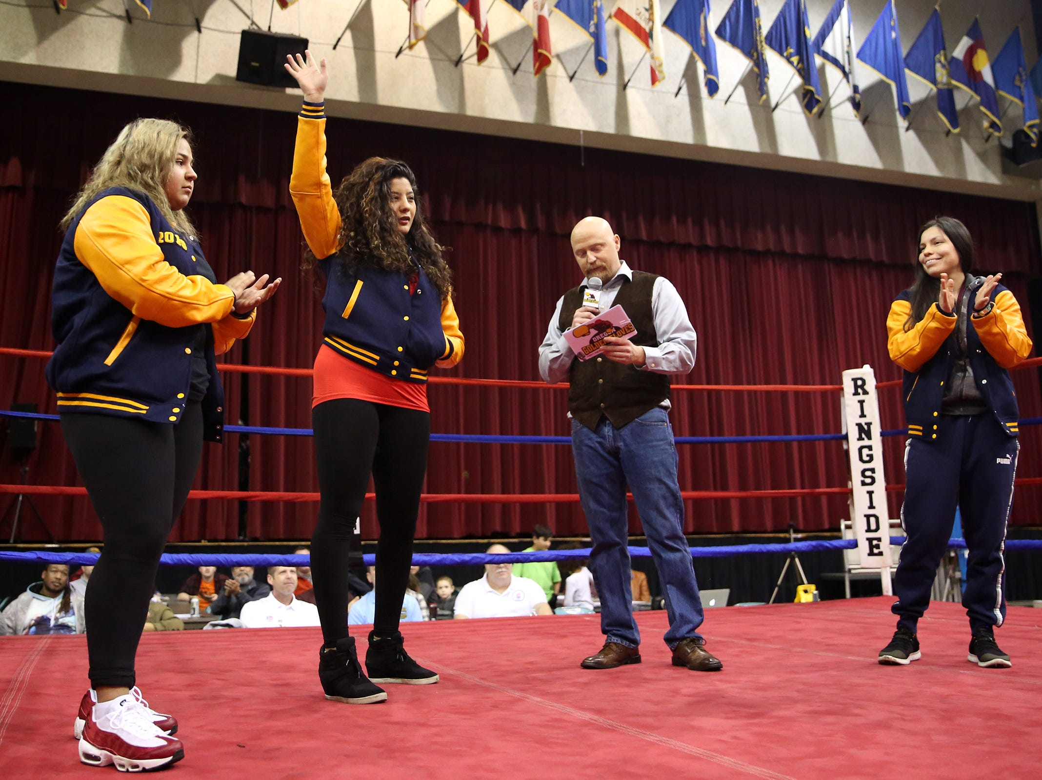 Oregon Golden Gloves female championship winners Angie Ornelas, Diana Estrada and Akayla Devereaux are recognized by director Daniel Dunn at the Salem Armory on Saturday, Feb. 2, 2019.