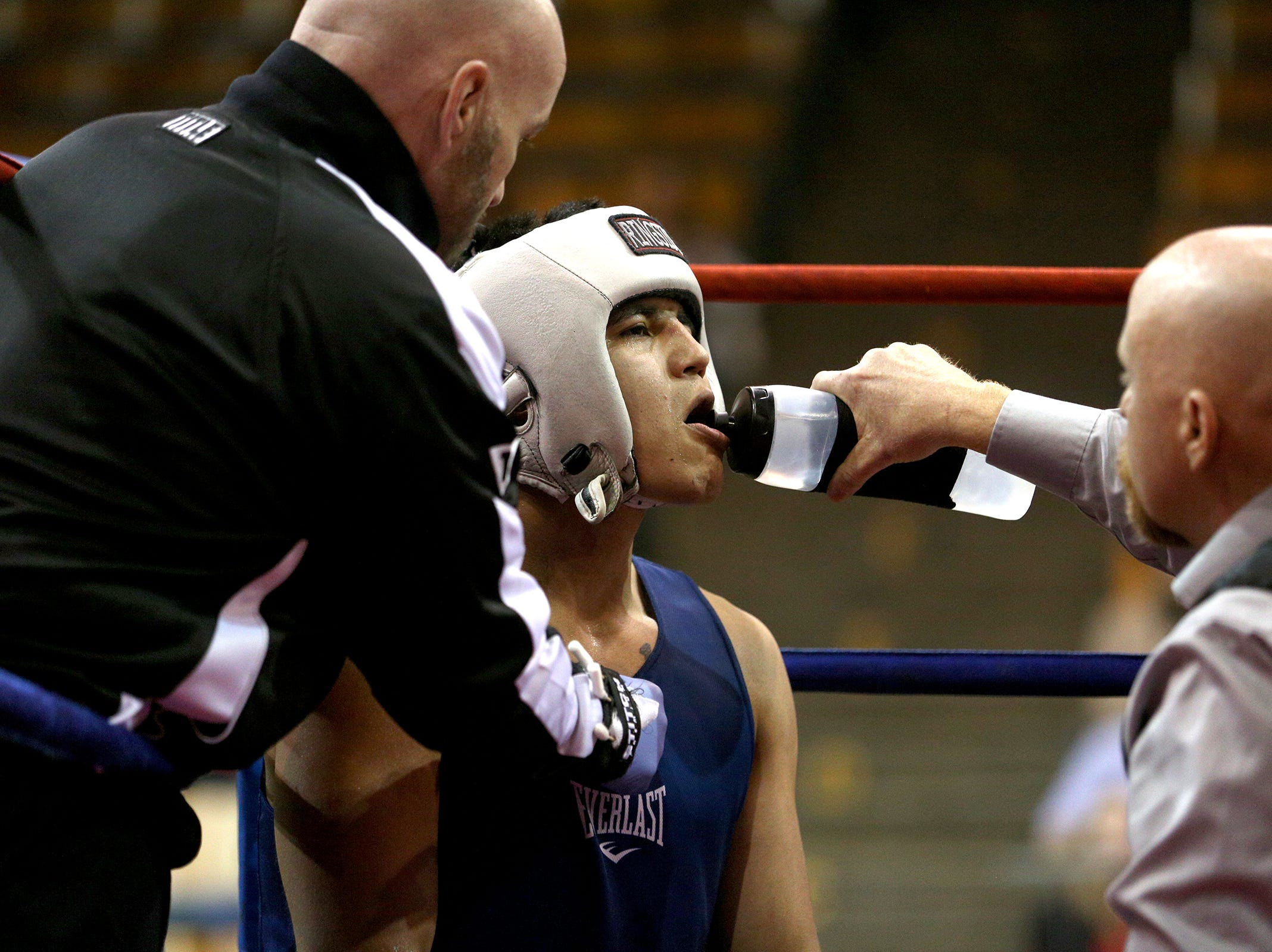 Omar Murillo of Salem takes a break with his trainer Daniel Dunn at the Oregon Golden Gloves championship matches at the Salem Armory on Saturday, Feb. 2, 2019.