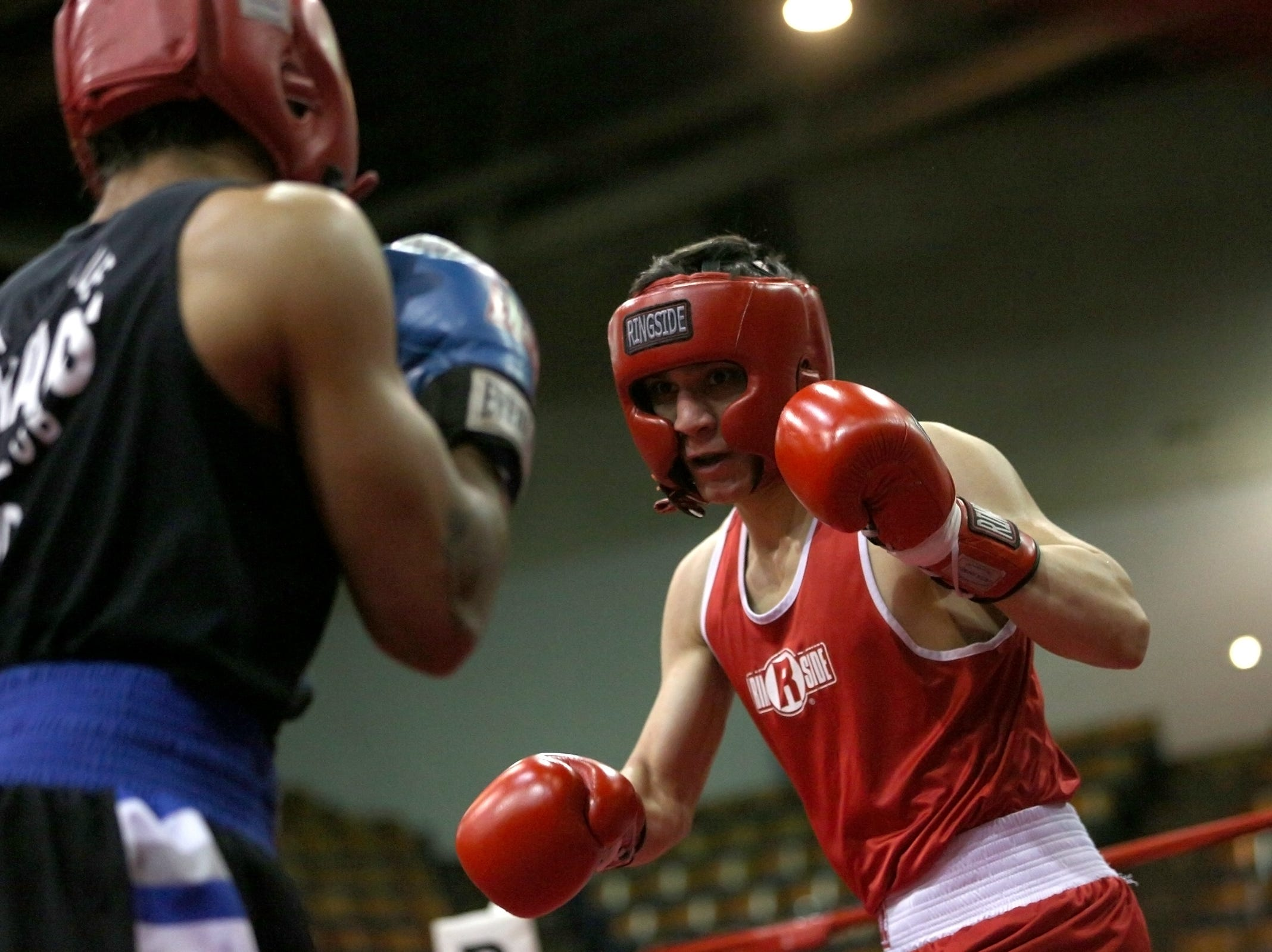 Daniel Schneegans of Hillsboro (right) takes on Bryan Sanchez of Portland during the Oregon Golden Gloves championship matches at the Salem Armory on Saturday, Feb. 2, 2019.