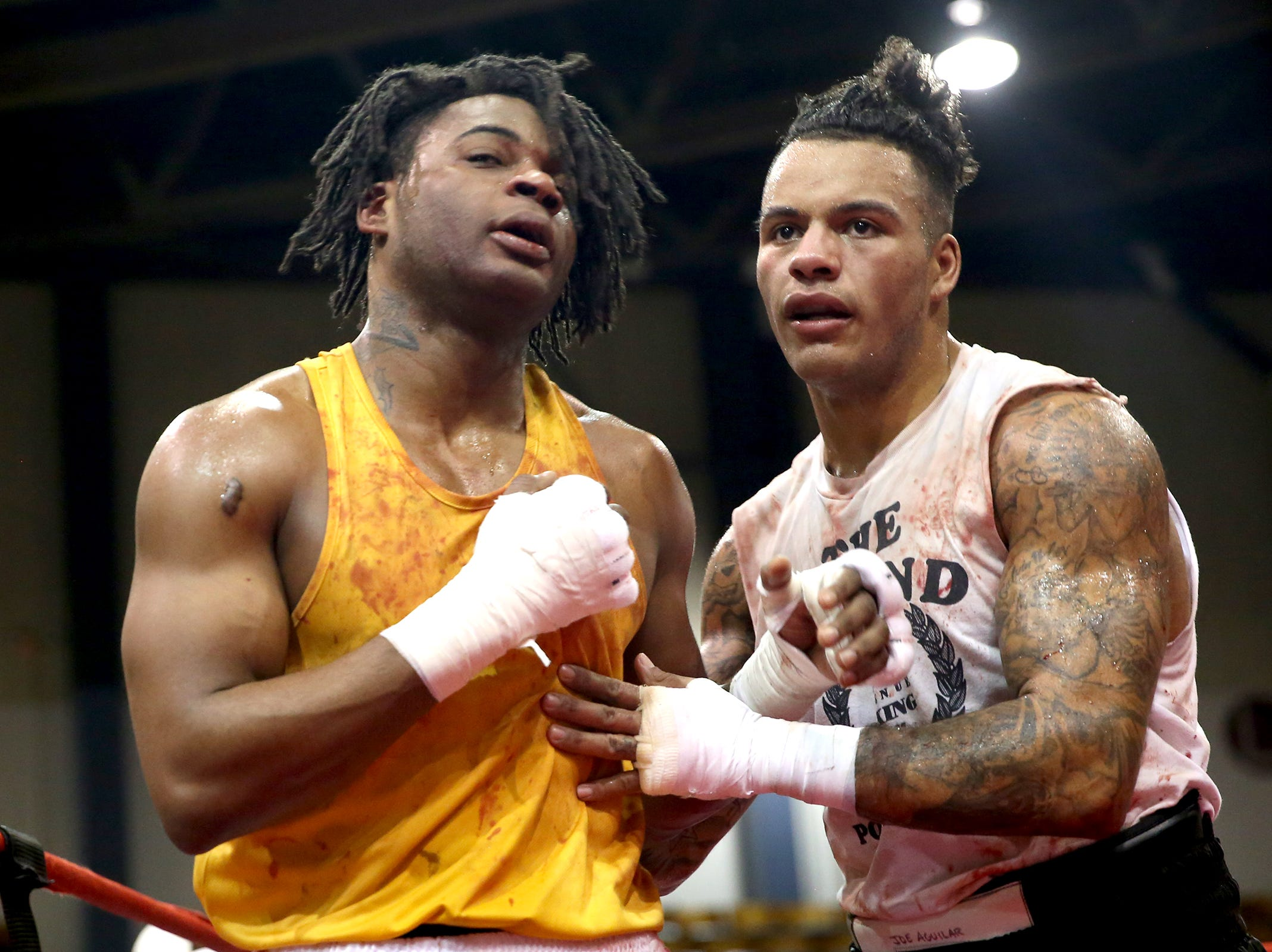 Joseph Aguilar (right) of Happy Valley and Terance Oddie of Vancouver (left) at the Oregon Golden Gloves championship matches at the Salem Armory on Saturday, Feb. 2, 2019. Aguilar was victorious in the match and received an award as best fighter of the tournament.
